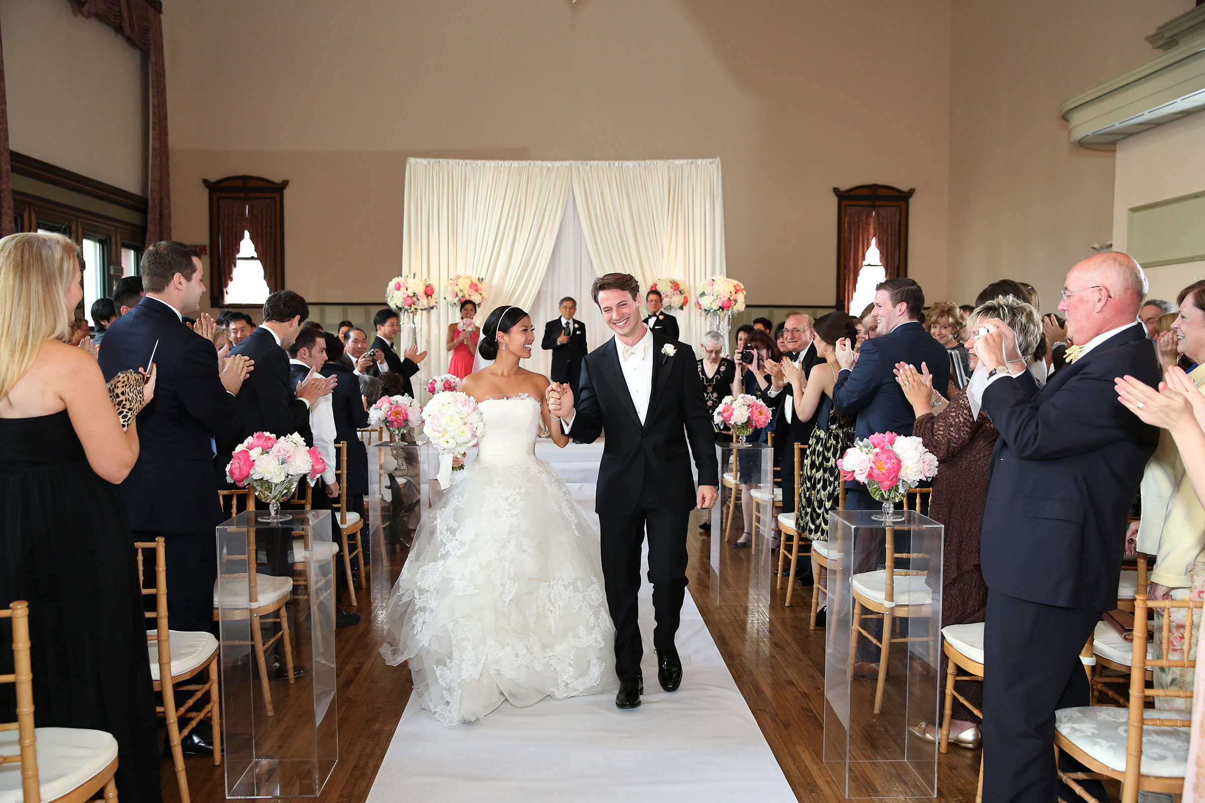 Bride and groom walk down the aisle - photo by Kenny Kim Photography