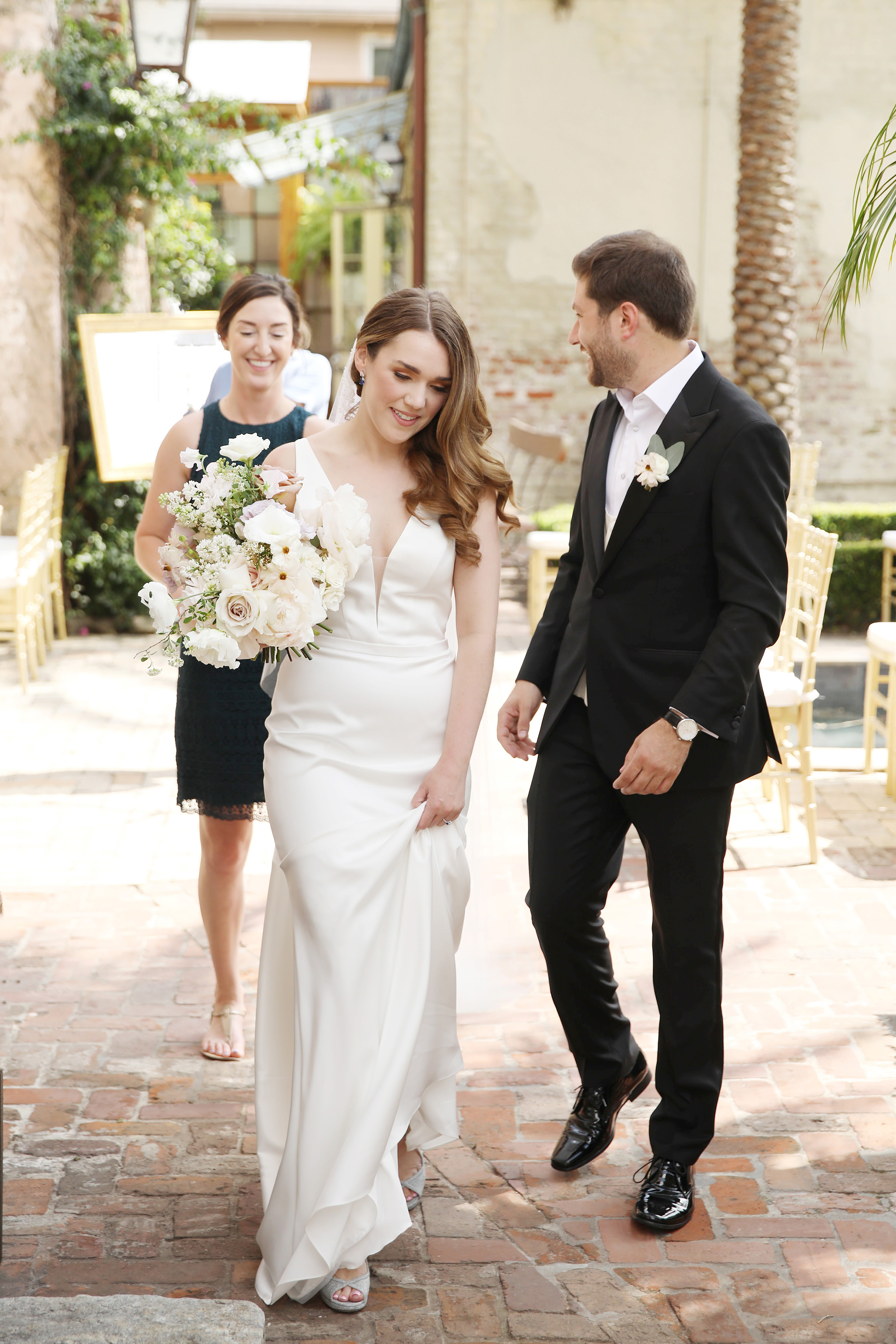 Bride and groom walking with planner - photo by Kenny Kim Photography