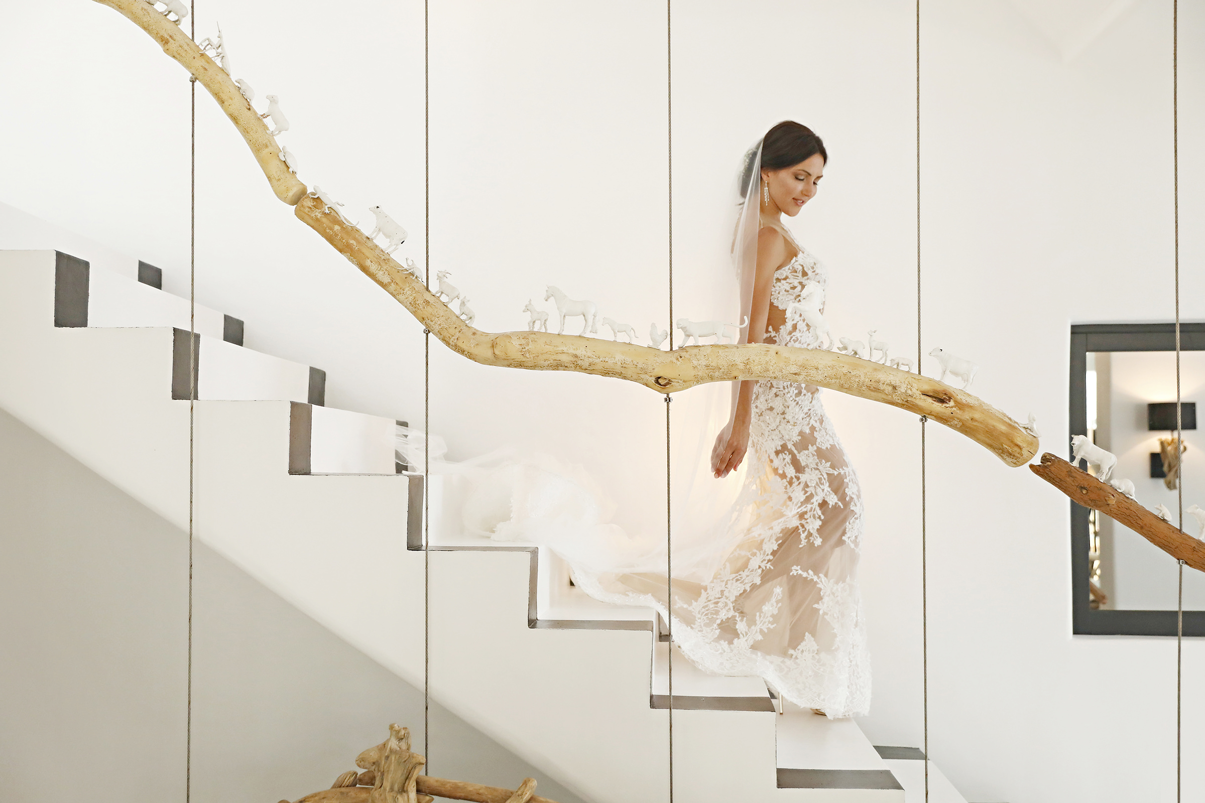 Bride descending stairs in lace gown and veil - photo by Kenny Kim Photography