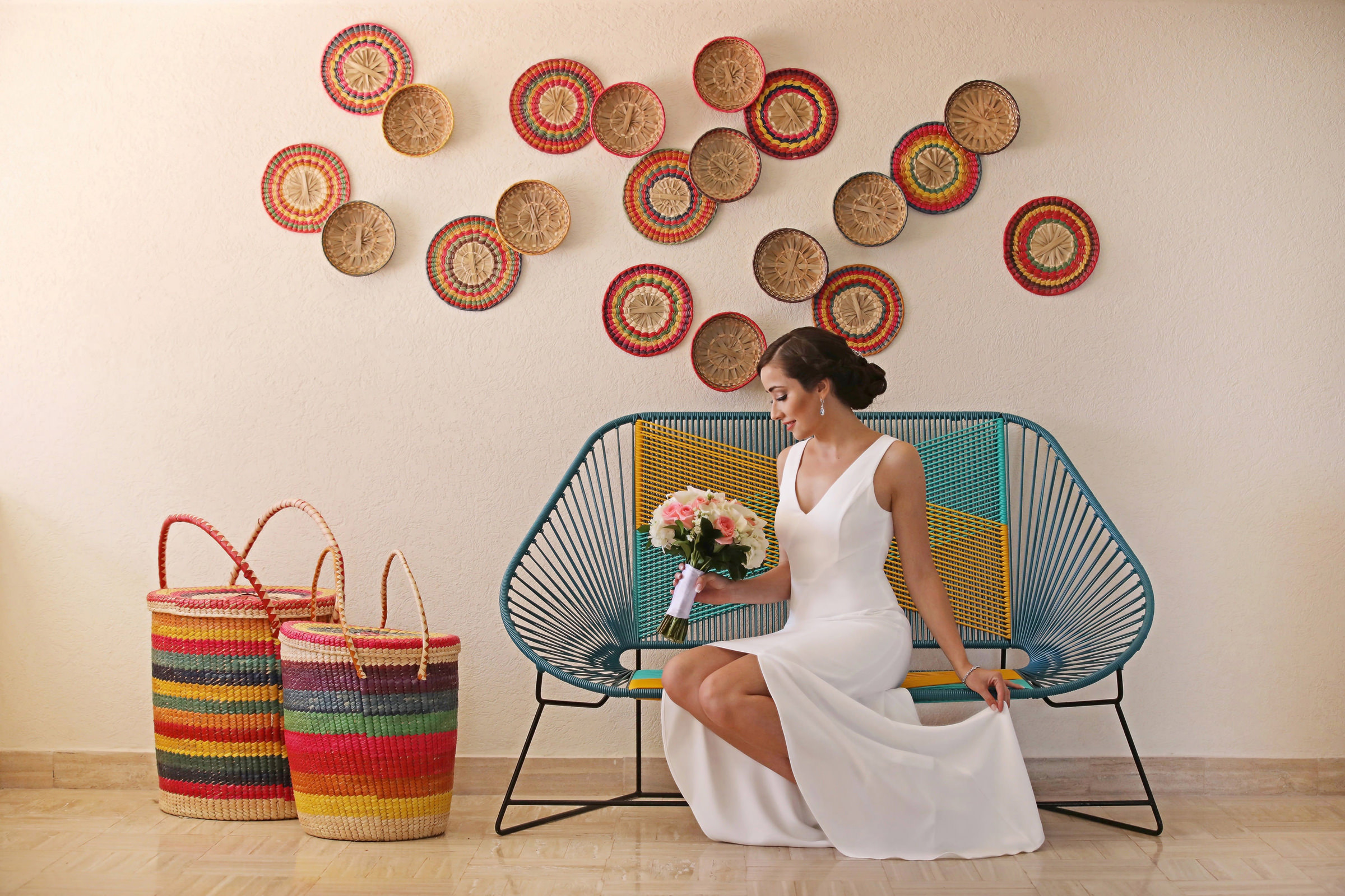 Bride portrait against colorful local basketry - photo by Kenny Kim Photography