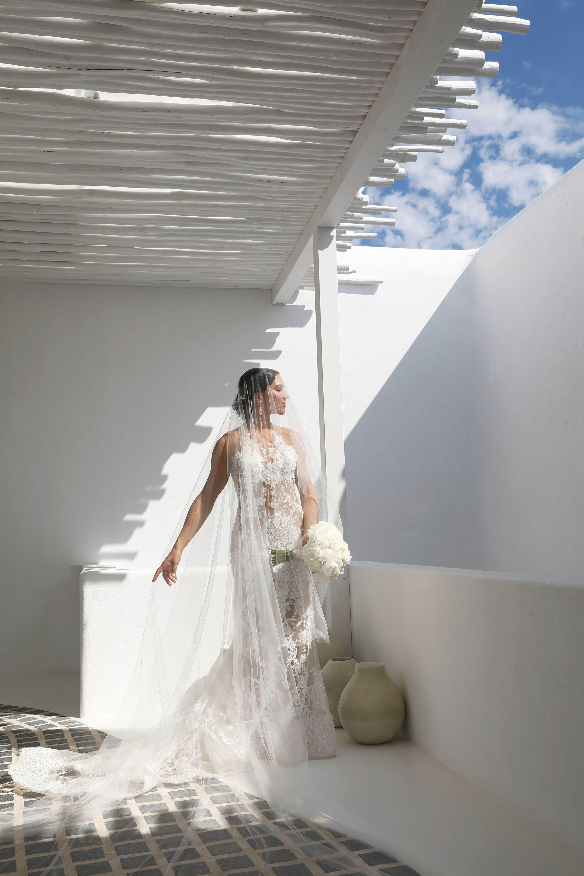 Bride posing against white outdoors - photo by Kenny Kim Photography