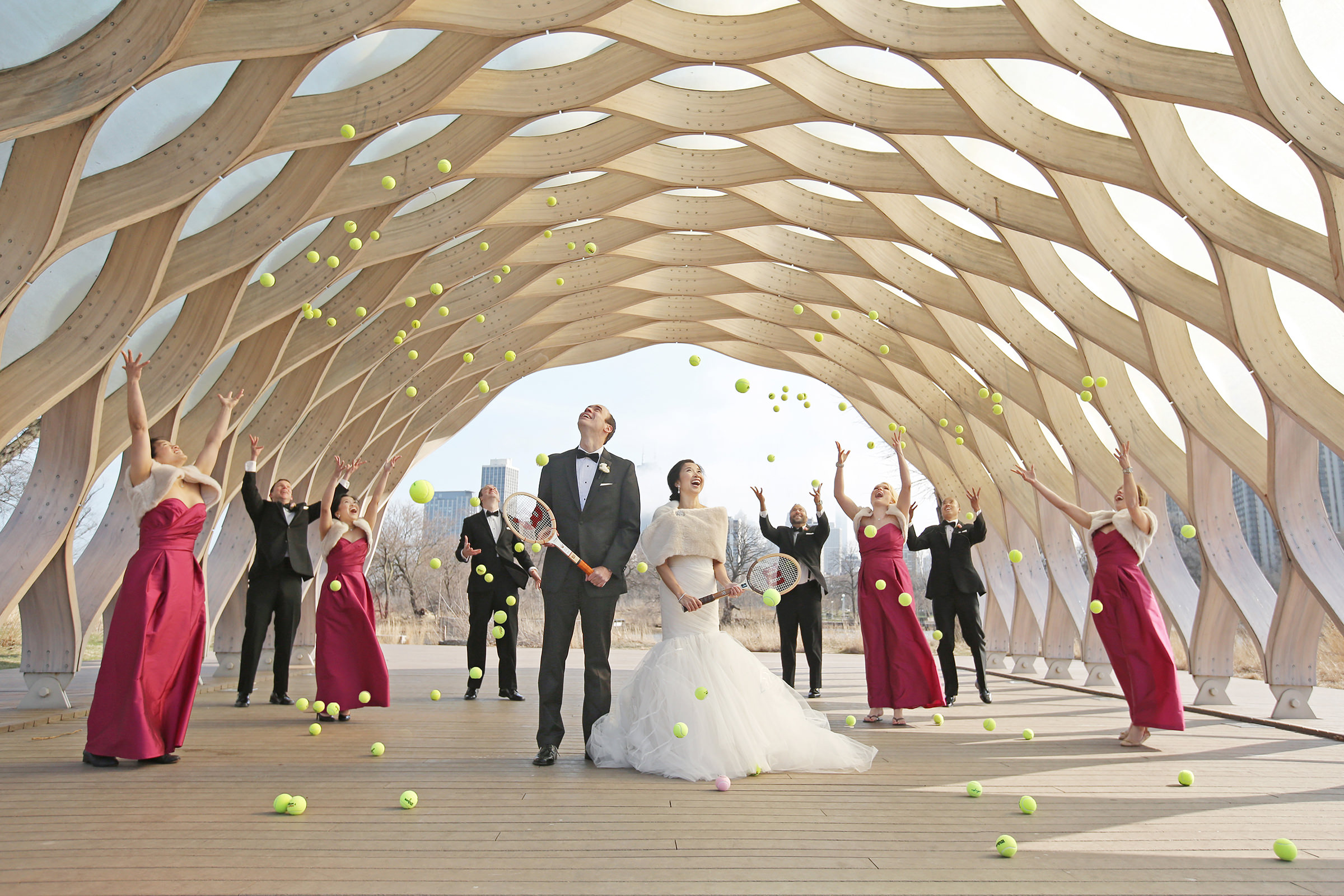 Couple and bridal party showered with tennis balls - photo by Kenny Kim Photography