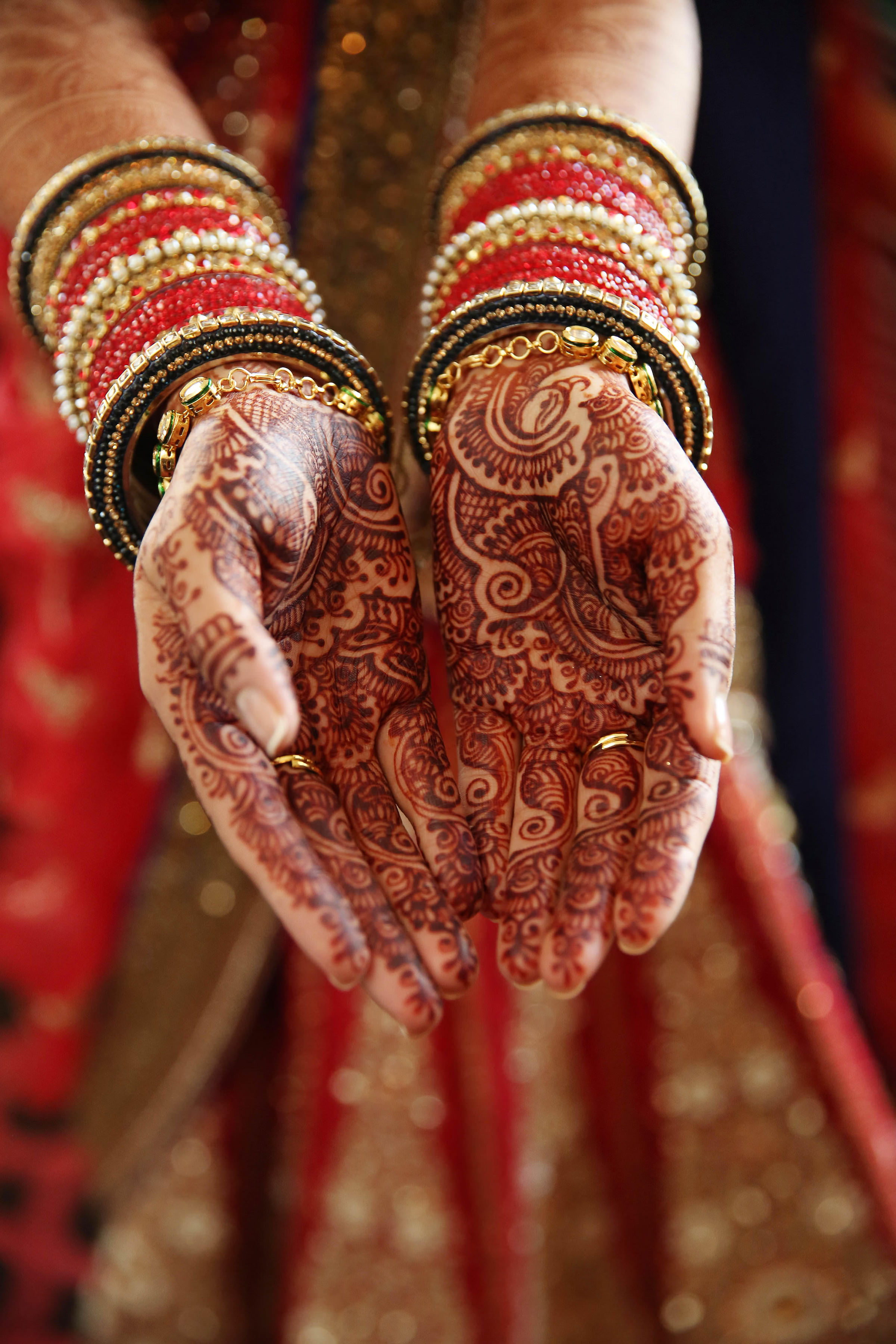 Detail of hands with henna and jewelry - photo by Kenny Kim Photography