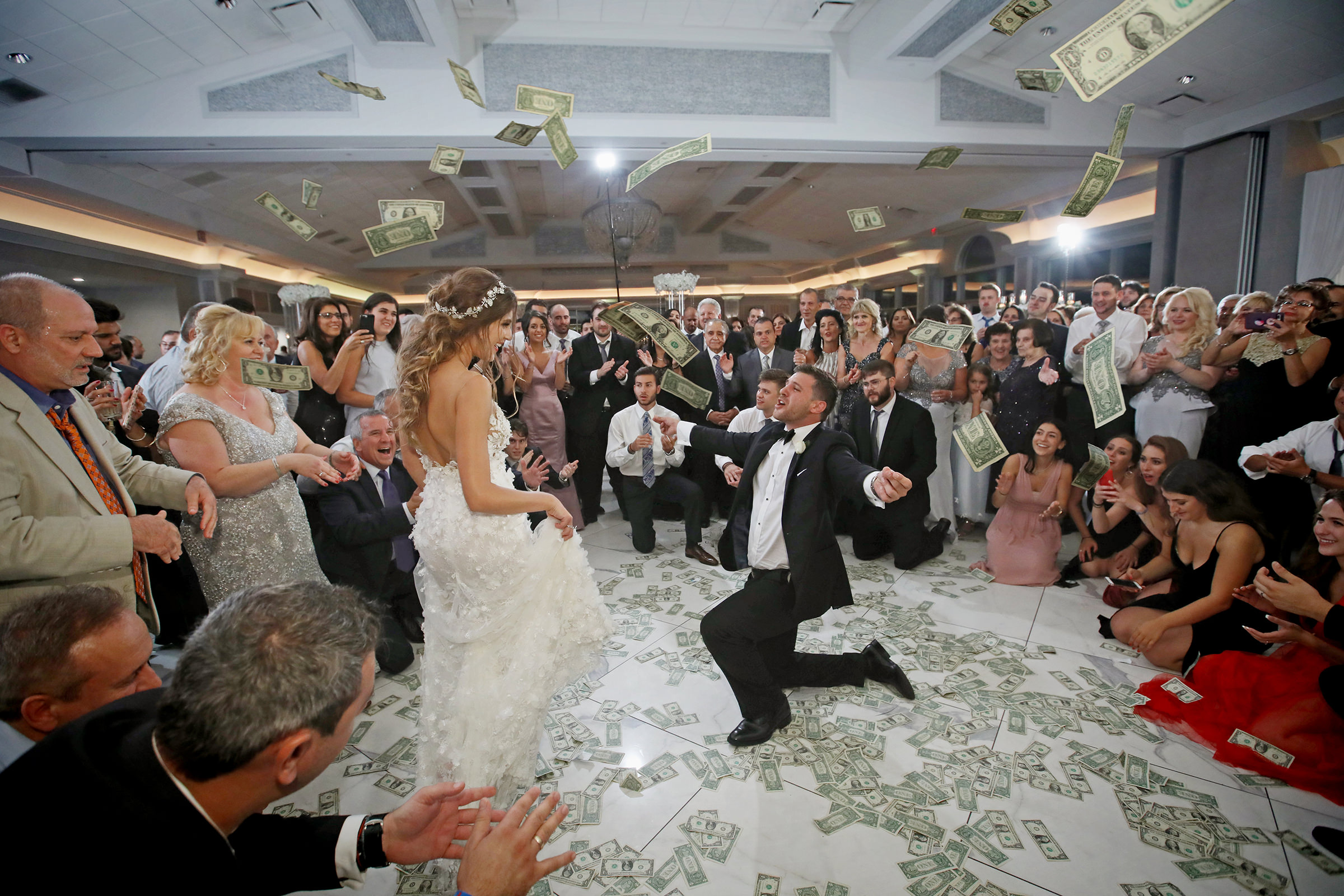 Groom and bride money dance during reception - photo by Kenny Kim Photography