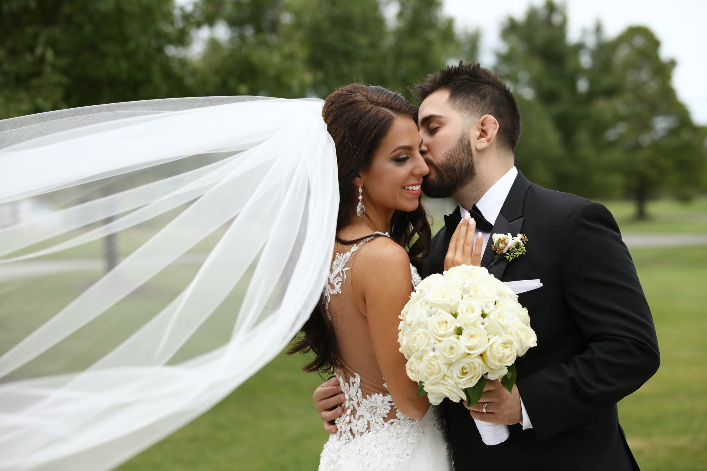 Groom and bride with veil in the breeze - photo by Kenny Kim Photography