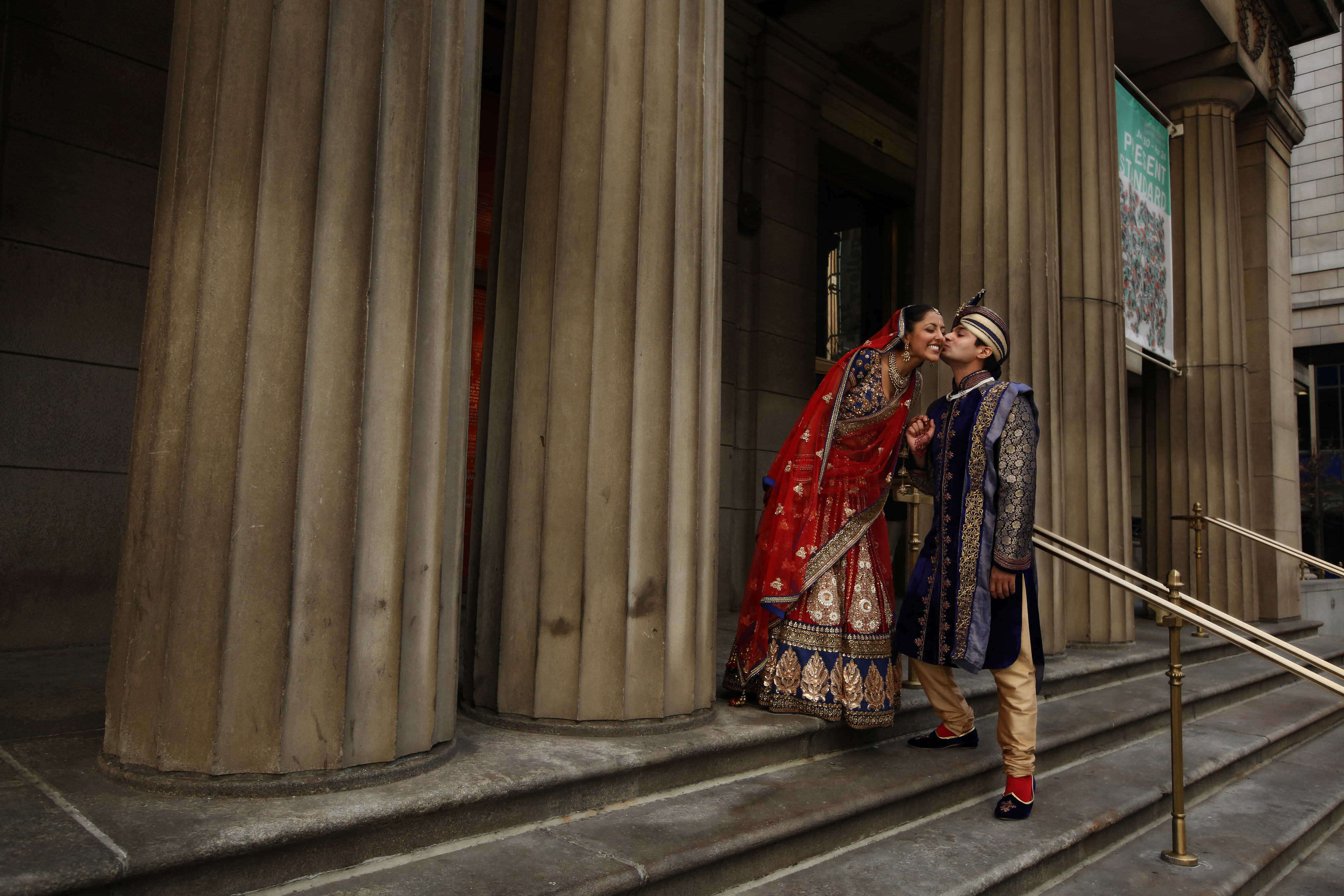 Indian couple kiss - photo by Kenny Kim Photography