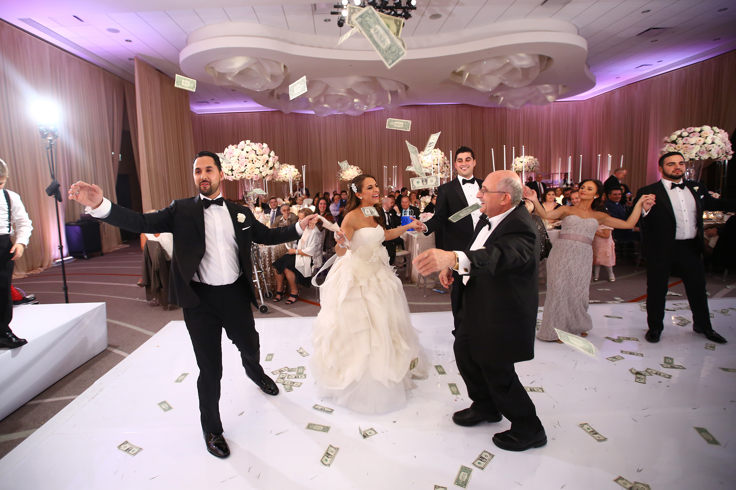 Money dance couple with family - photo by Kenny Kim Photography