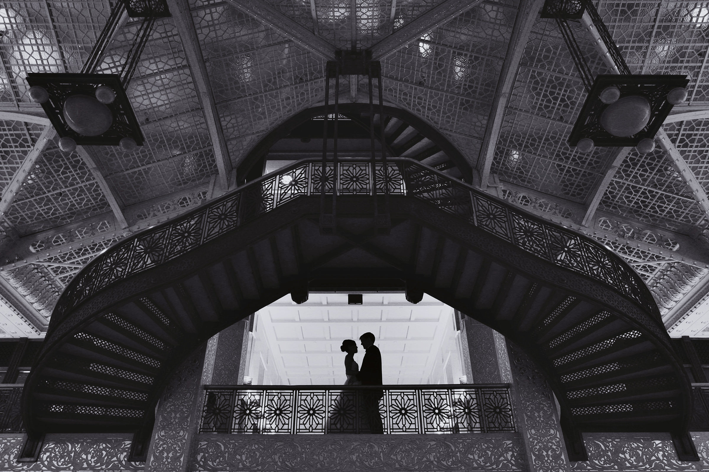 Silhouette couple against ornate architecture - photo by Kenny Kim Photography