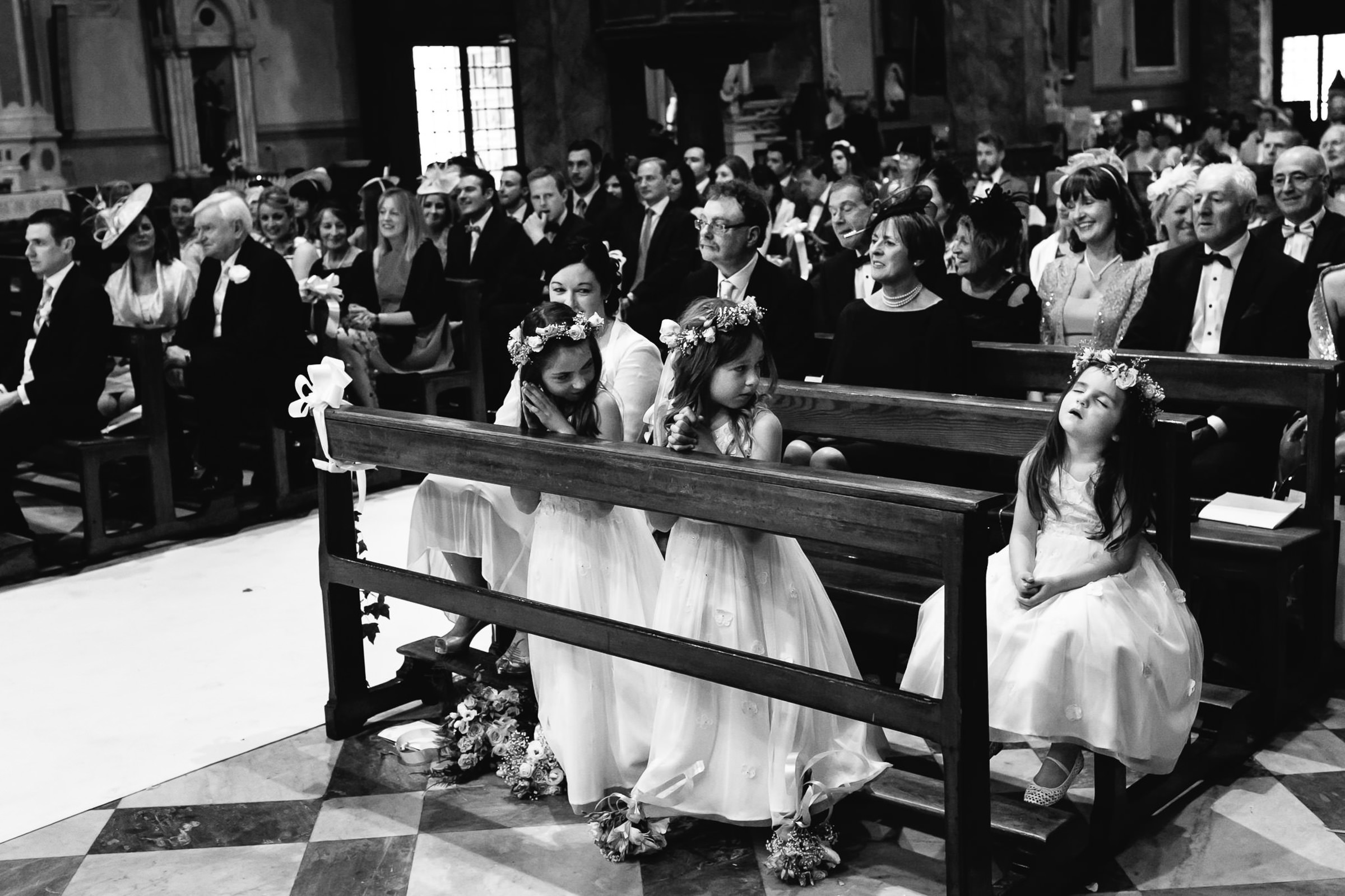 Flower girls and guests at church ceremony - photo by Julian Kanz Photography