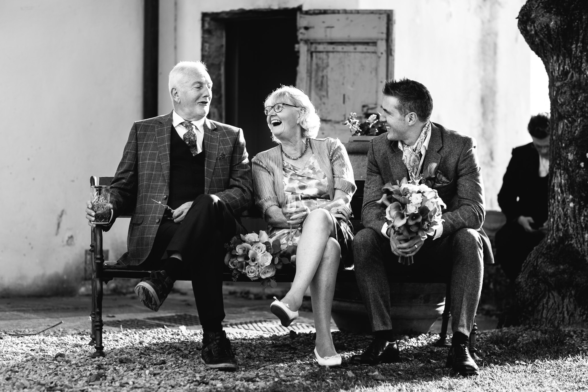 Groom shares a light moment with parents - photo by Julian Kanz Photography