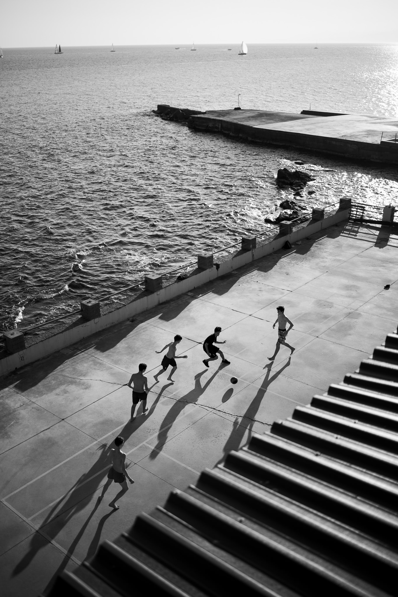 sea landscape with soccer players - photo by Julian Kanz Photography