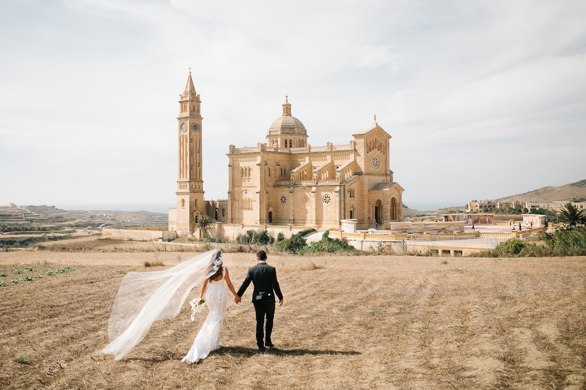 Couple approaches Santuario di Ta' Pinu, Malta - photo by Julian Kanz Photography