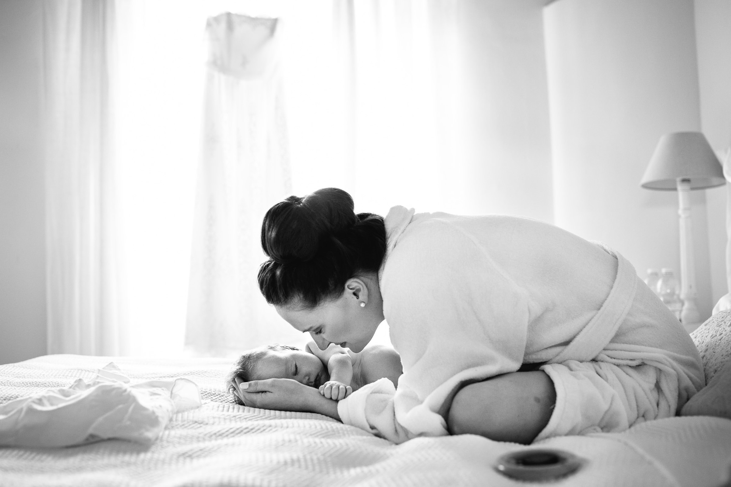 Woman on bed with adorable baby - photo by Julian Kanz Photography