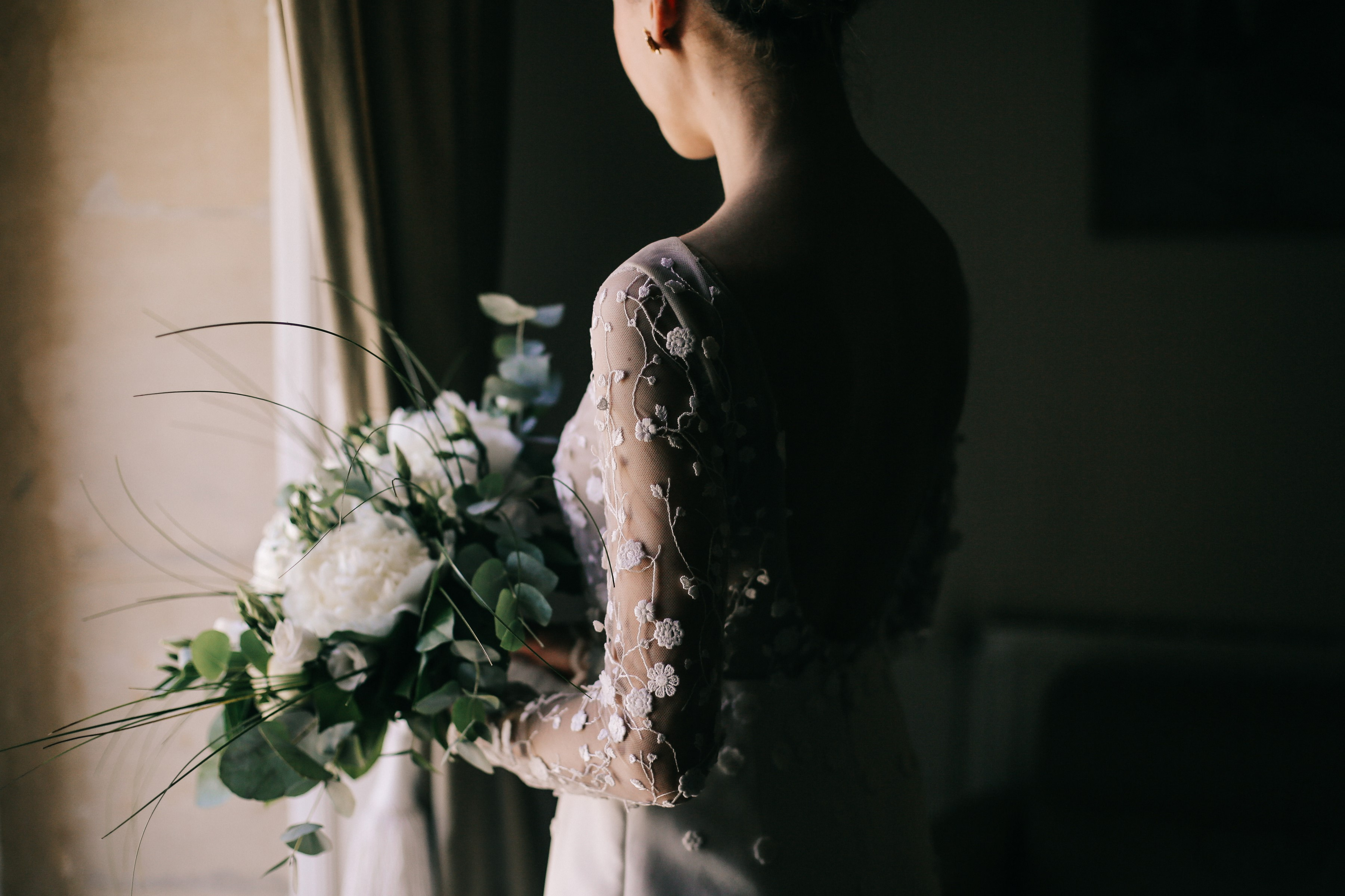 Backview detail of applique bridal gown - photo by Amandine Ropars