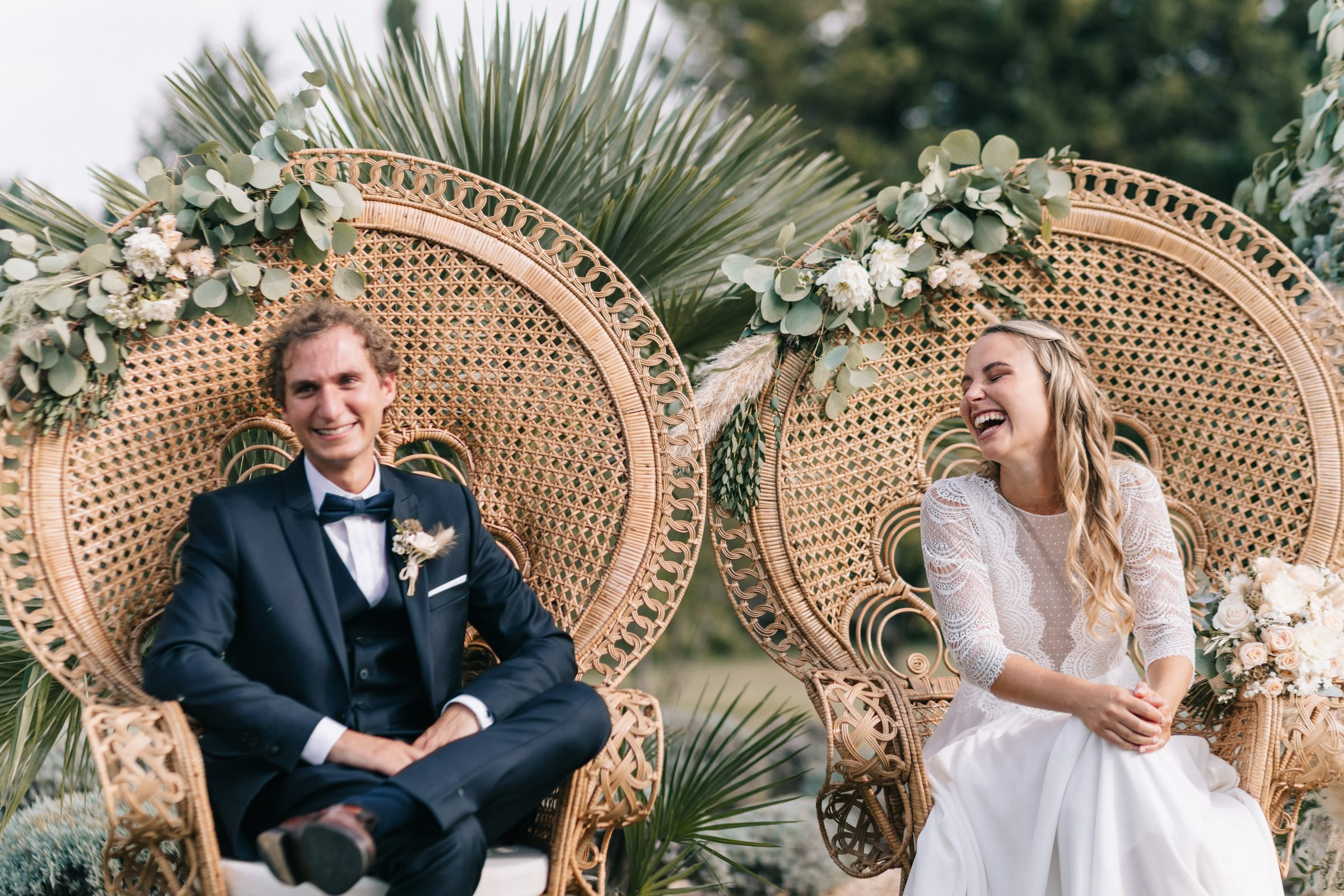 bride and groom laughing during toasts- photo by Amandine Ropars, france