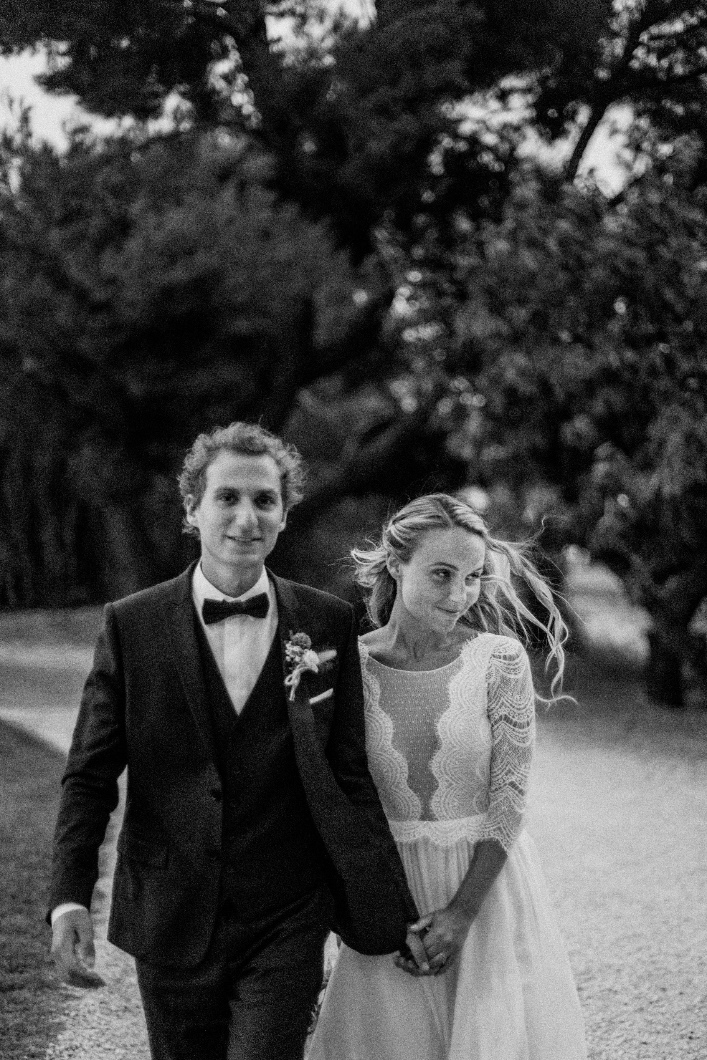 bride and groom sweet moment walking together- photo by Amandine Ropars, france