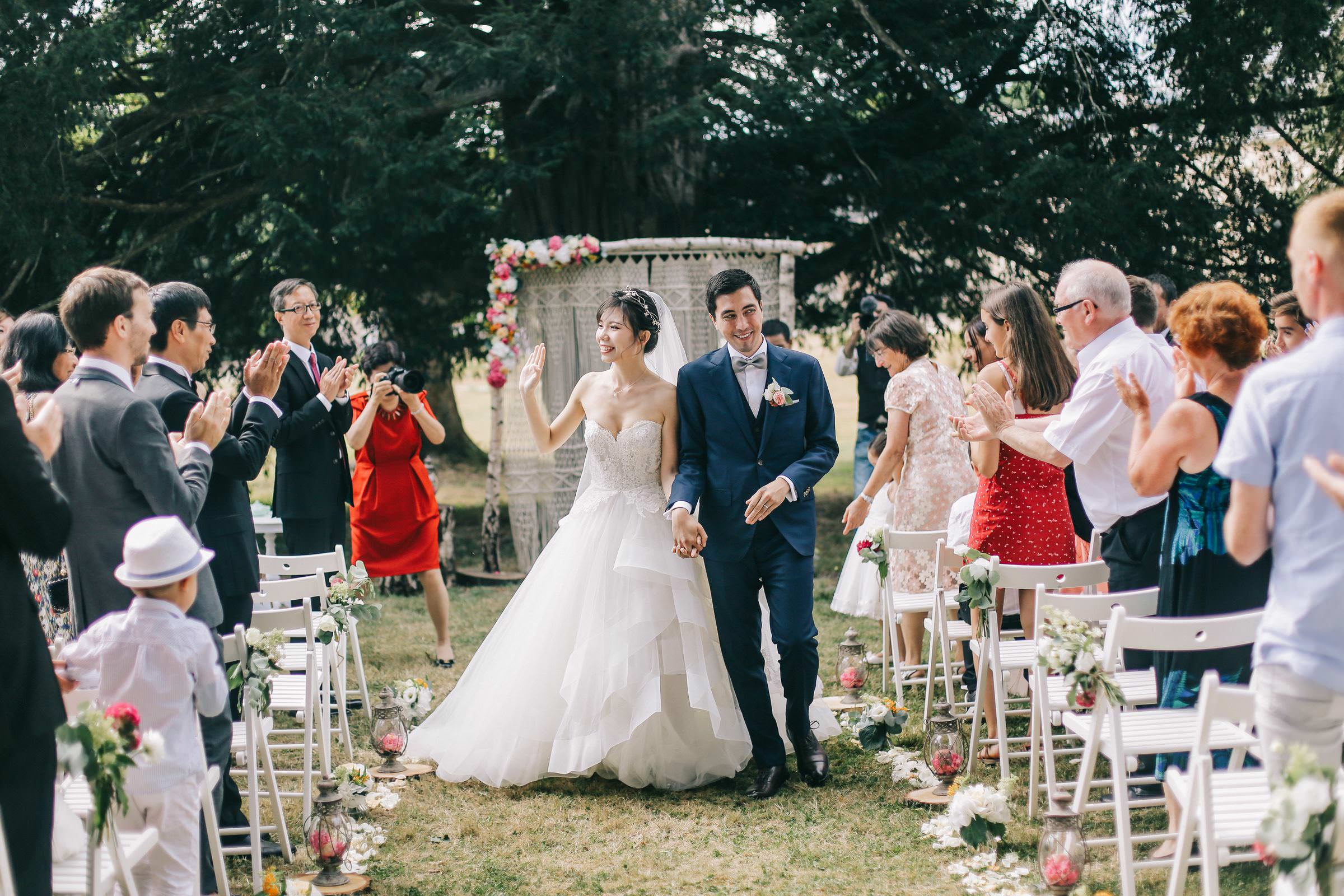 Outdoor couple recessional - photo by Amandine Ropars