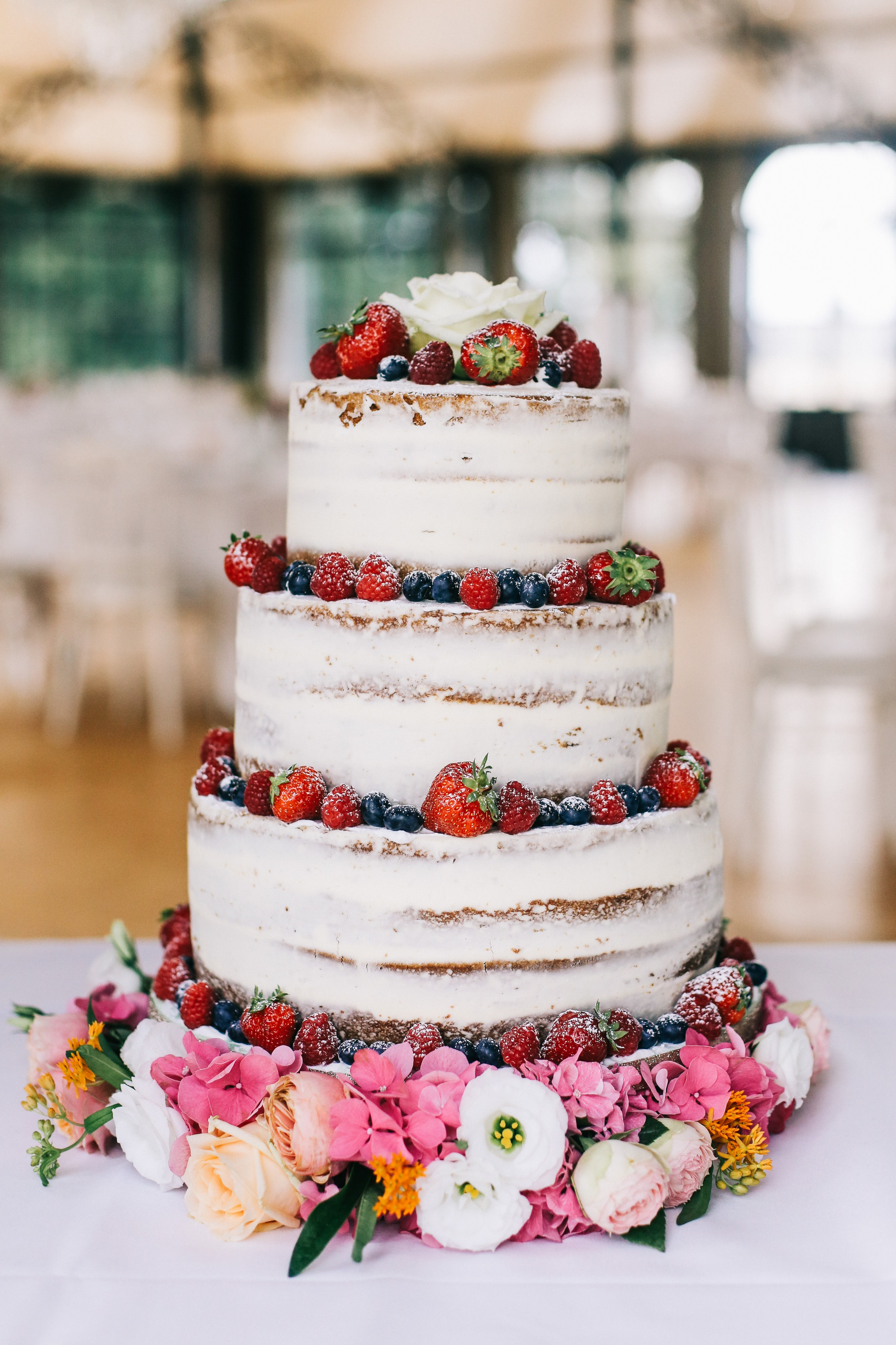 white wedding cake with berries- photo by Amandine Ropars, france