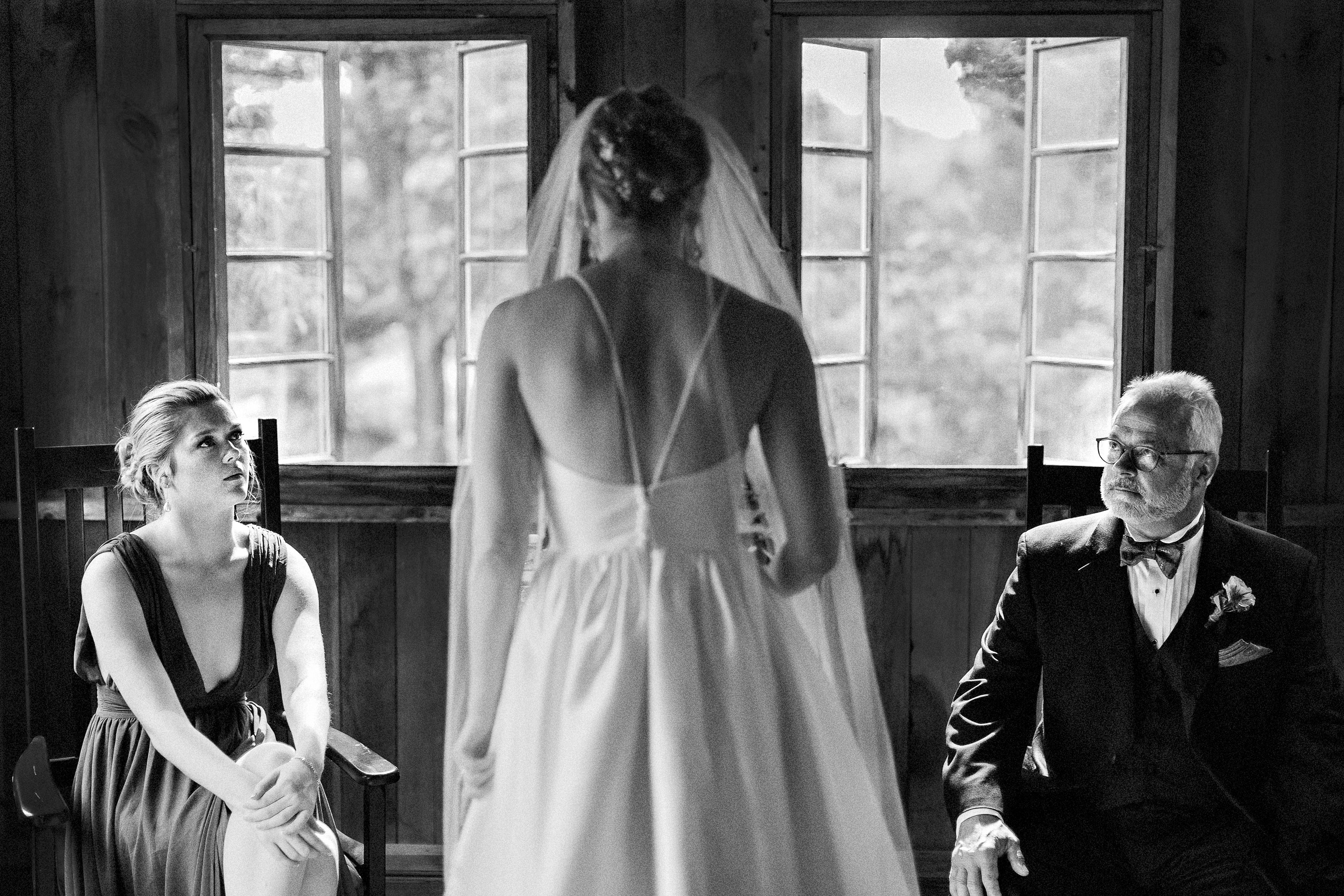 Bride with serious onlookers - photo by Alex Paul Photography