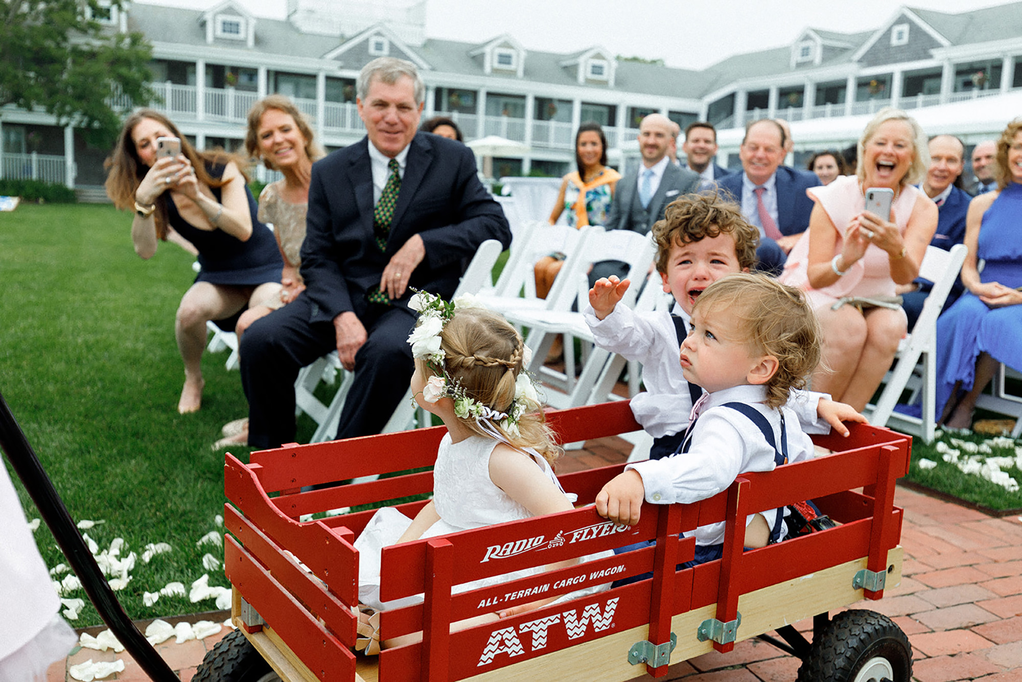 Guests watching kids riding in wagon - photo by Alex Paul Photography