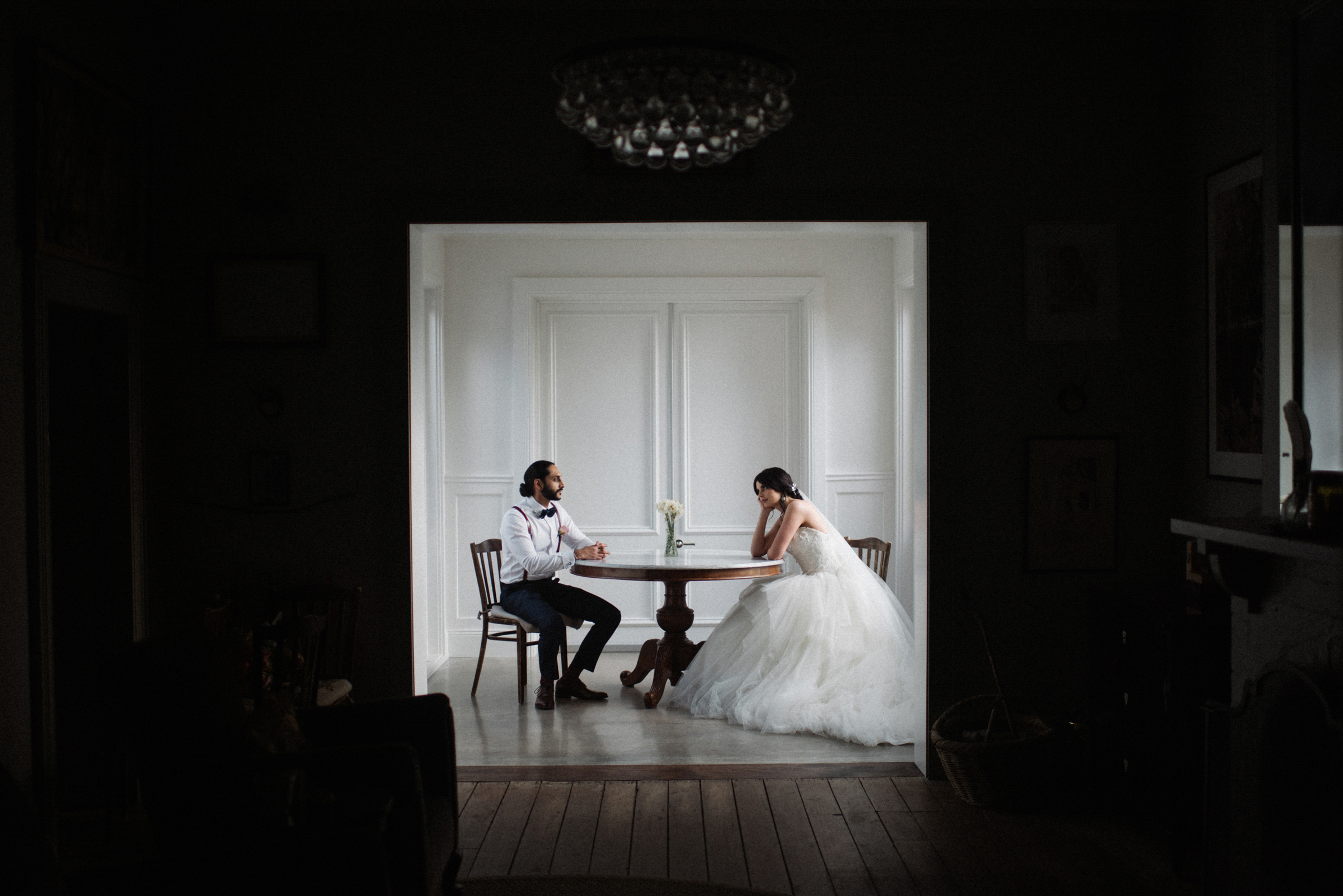 Bride and groom at table - photo by Ben Sowry Photo