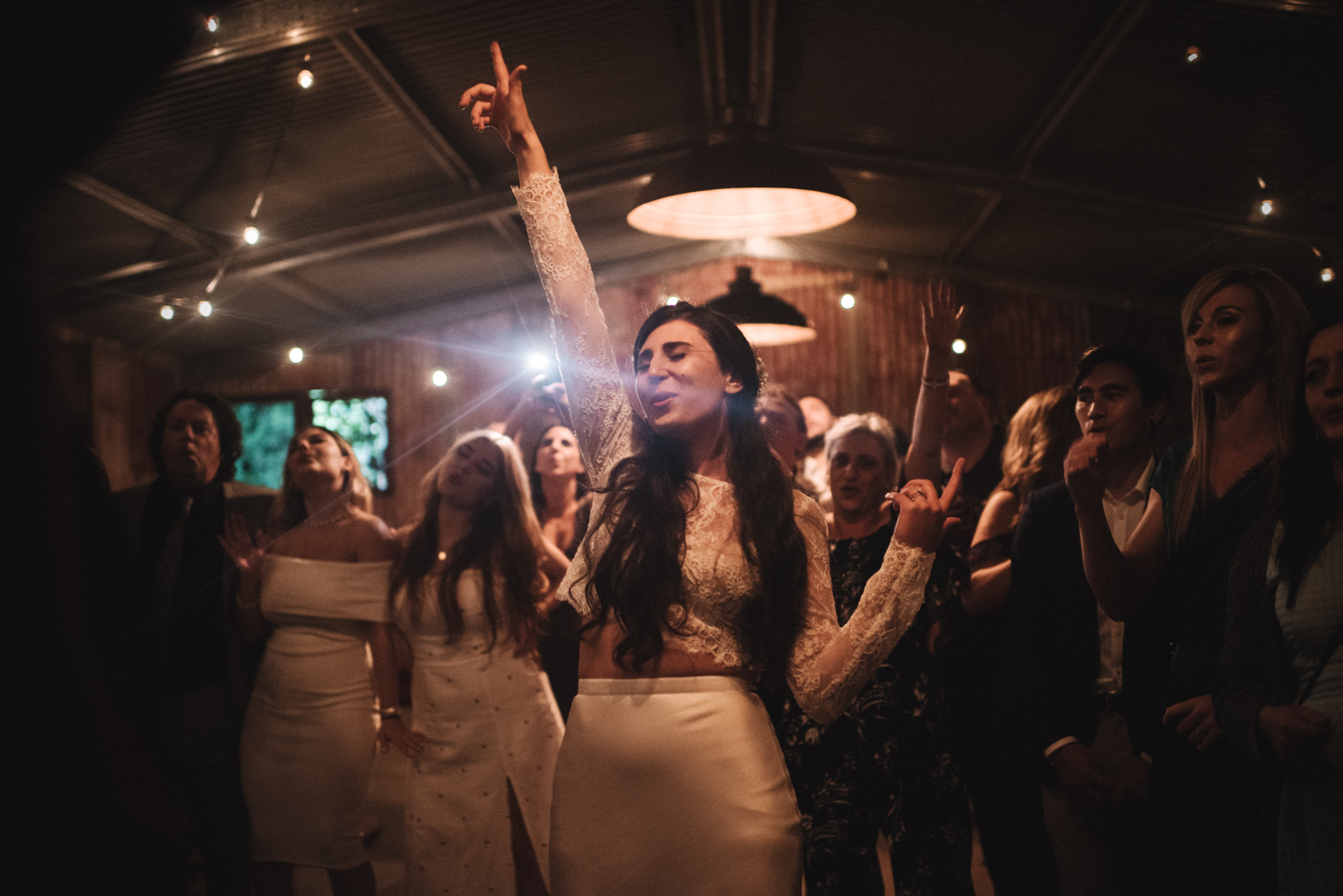 Bride and guests singing - photo by Ben Sowry Photo