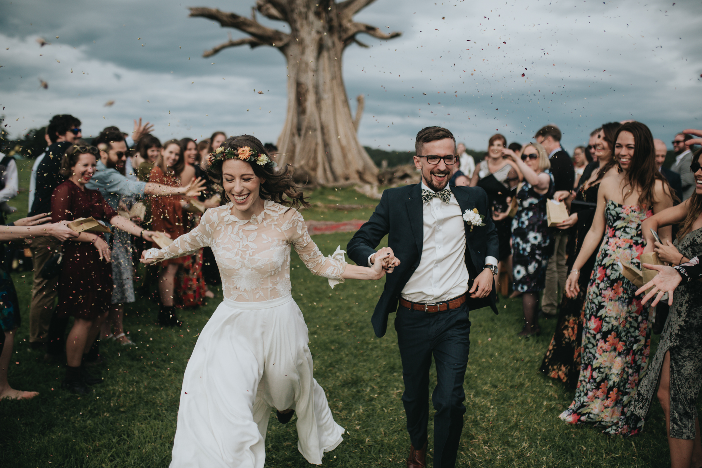 Couple running down outdoor aisle - photo by Ben Sowry Photo