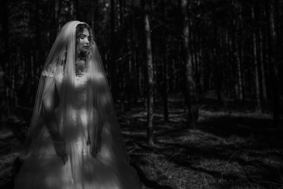 Bride in dappled forest light - photo by Motiejus - London photographer