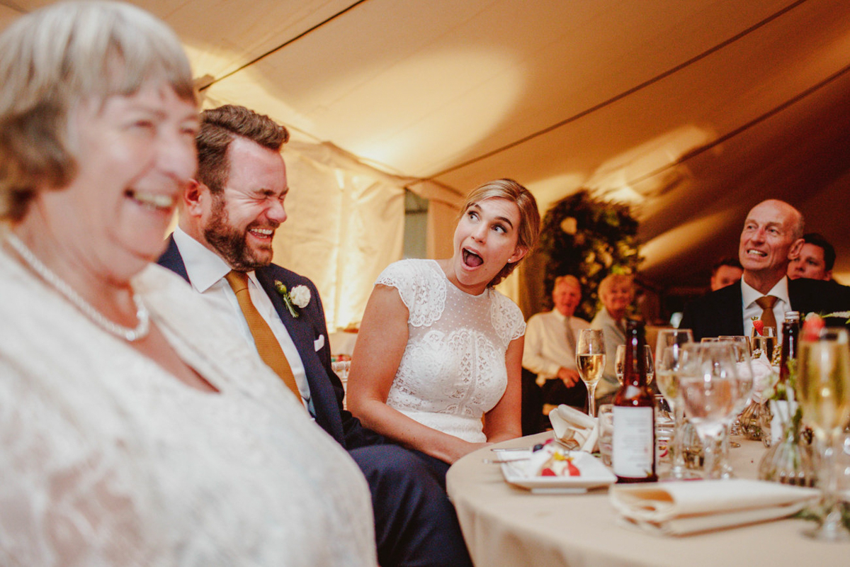 Bride reacts during toasts - photo by Motiejus