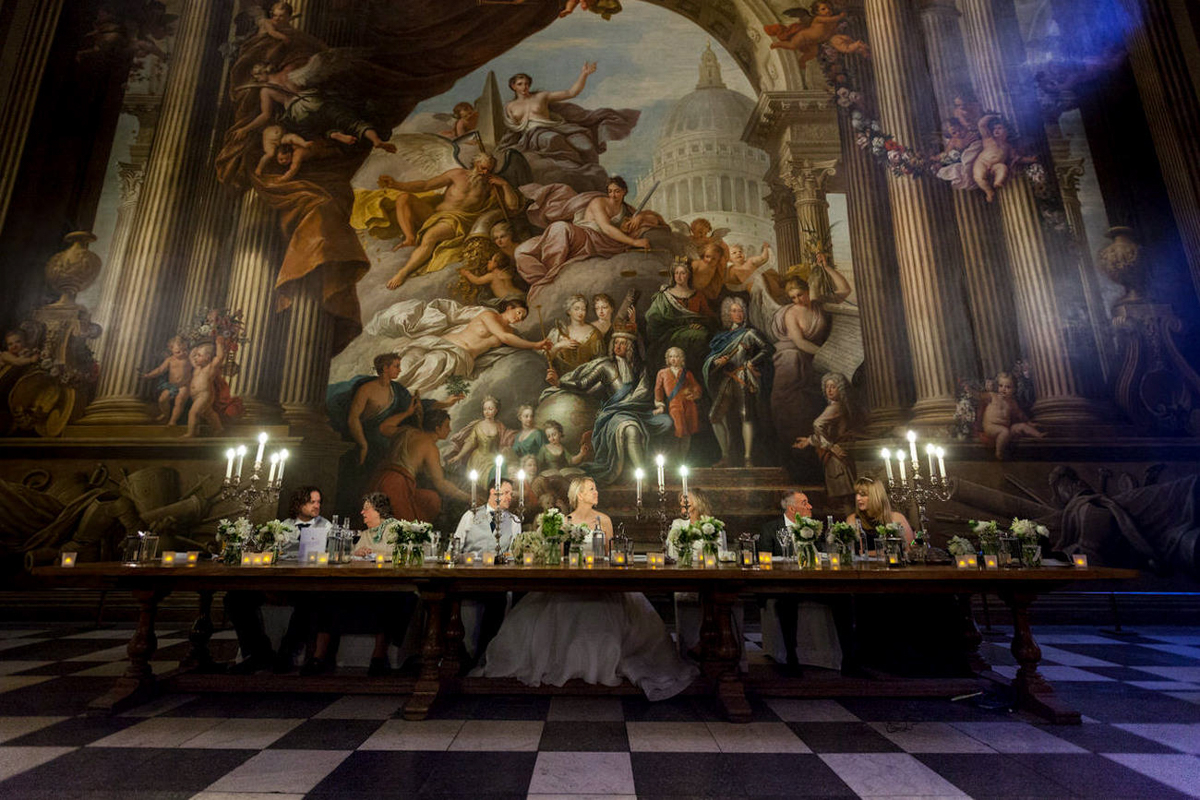 Candlelight wedding table in front of fresco mural - photo by Motiejus - UK photographer