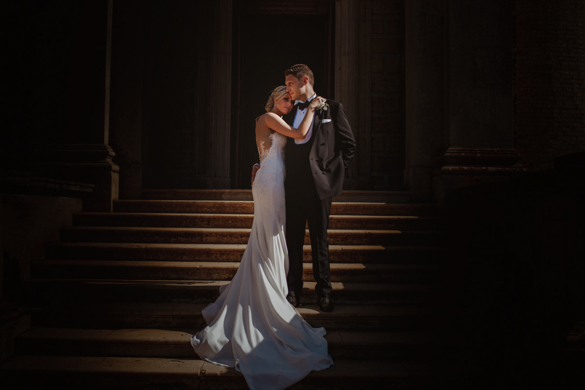 Fashionable couple on stairs with bride in crepe de chine - photo by Motiejus