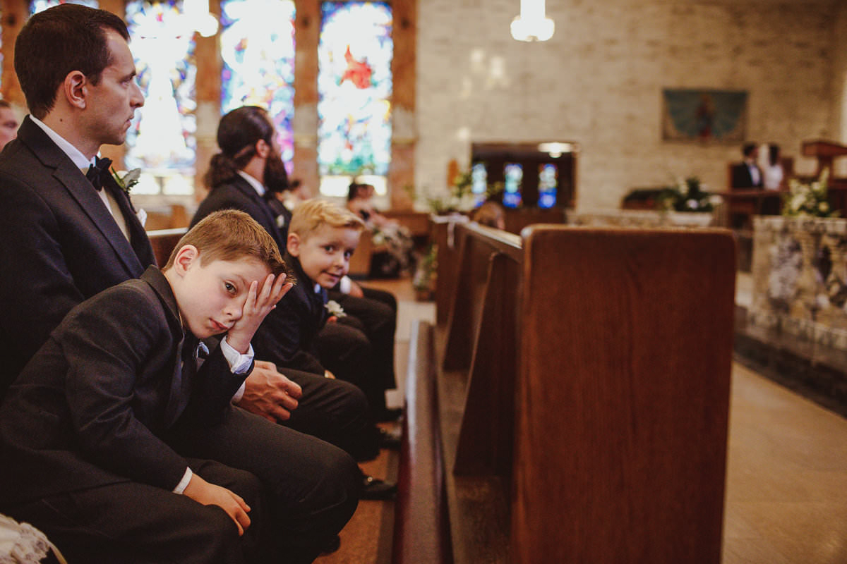 Kids being kids in church pews - photo by Motiejus