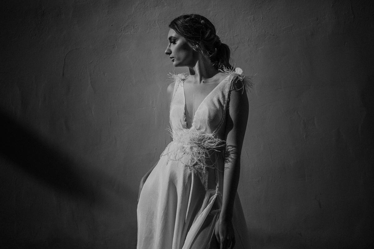 Bride in sleeveless plunging neckline wedding gown - photo by Motiejus