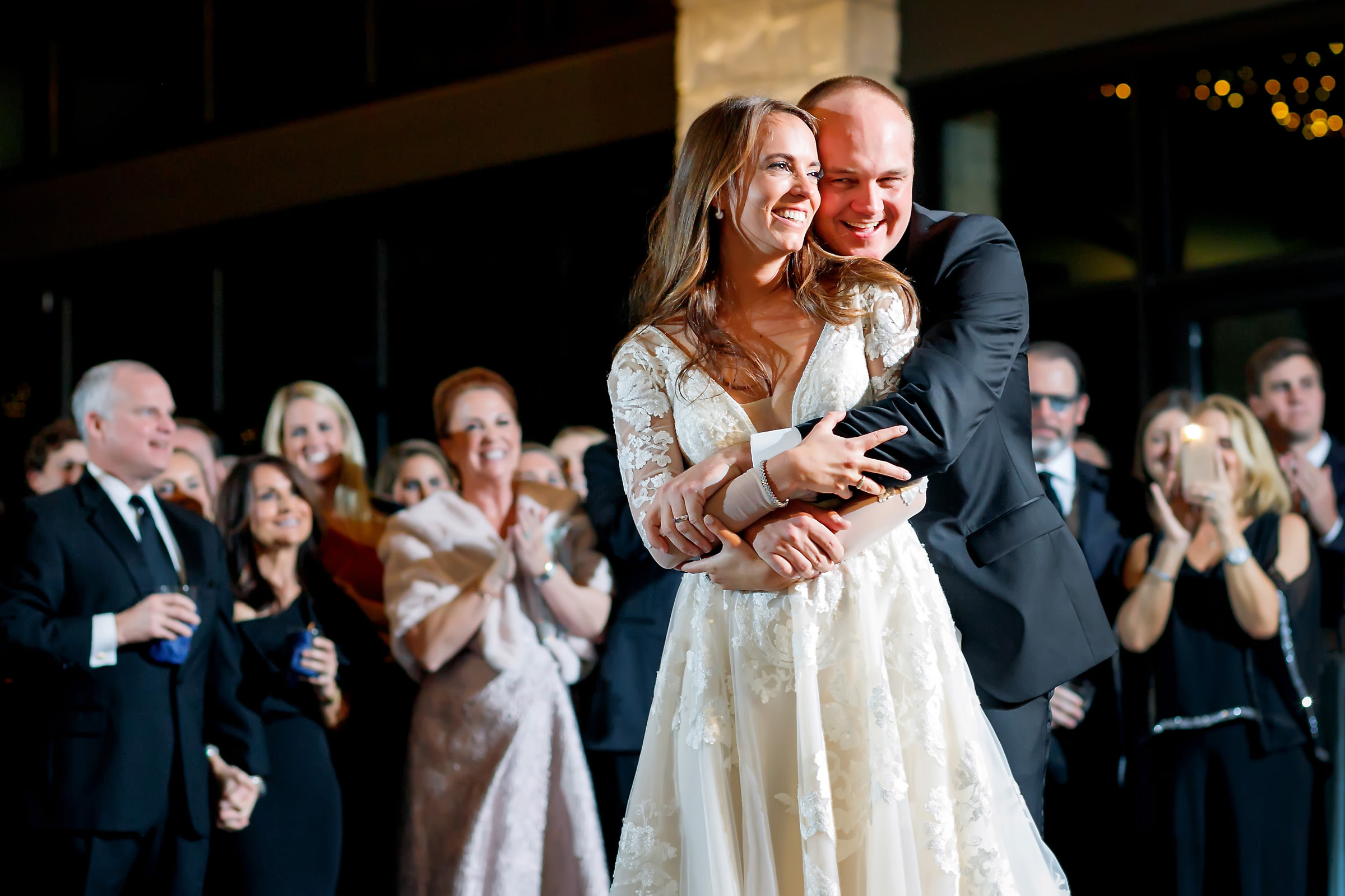 Couple embrace at reception - photo by Jenny DeMarco Photography
