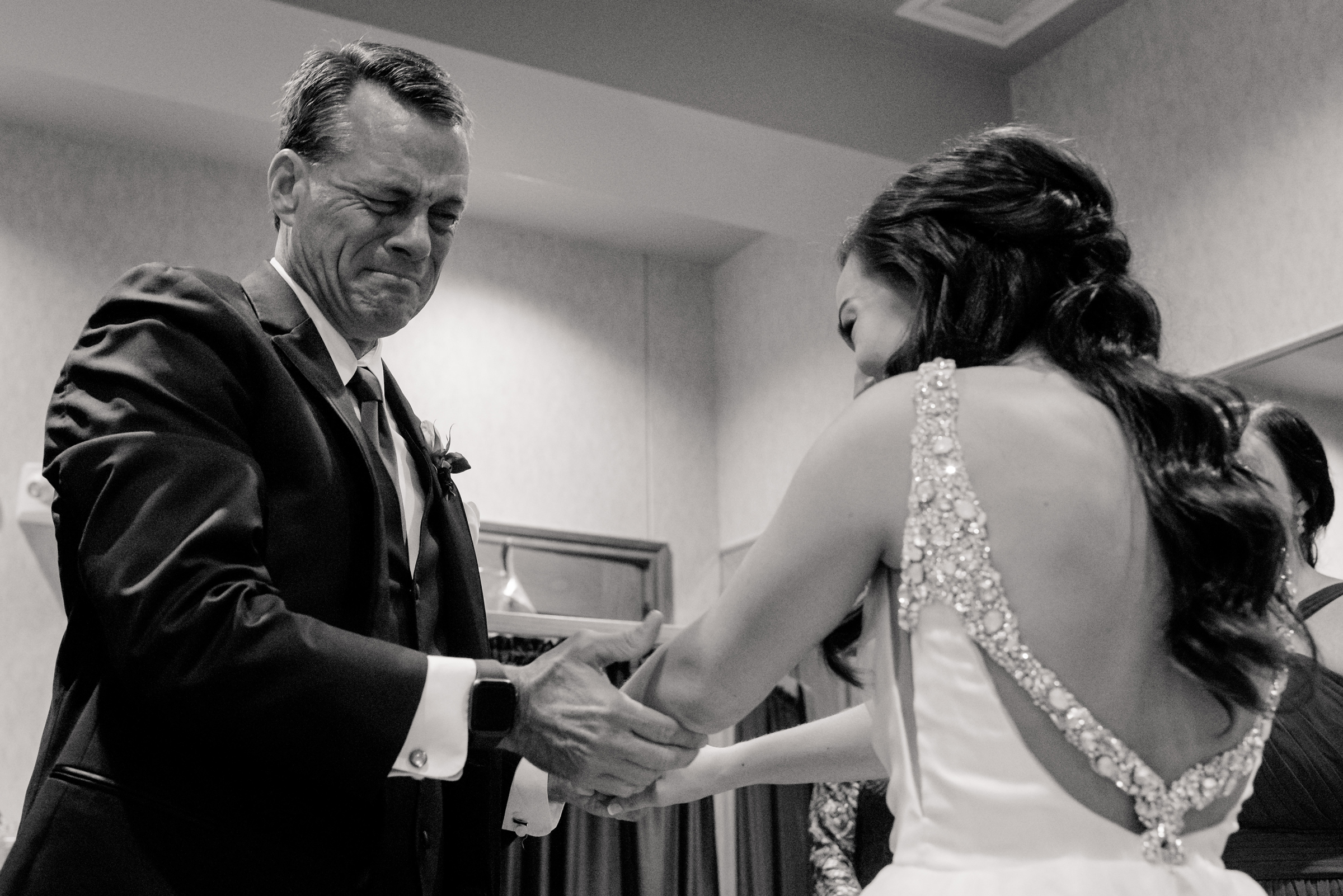 Father chokes up seeing daughter in gown - photo by Jenny DeMarco Photography