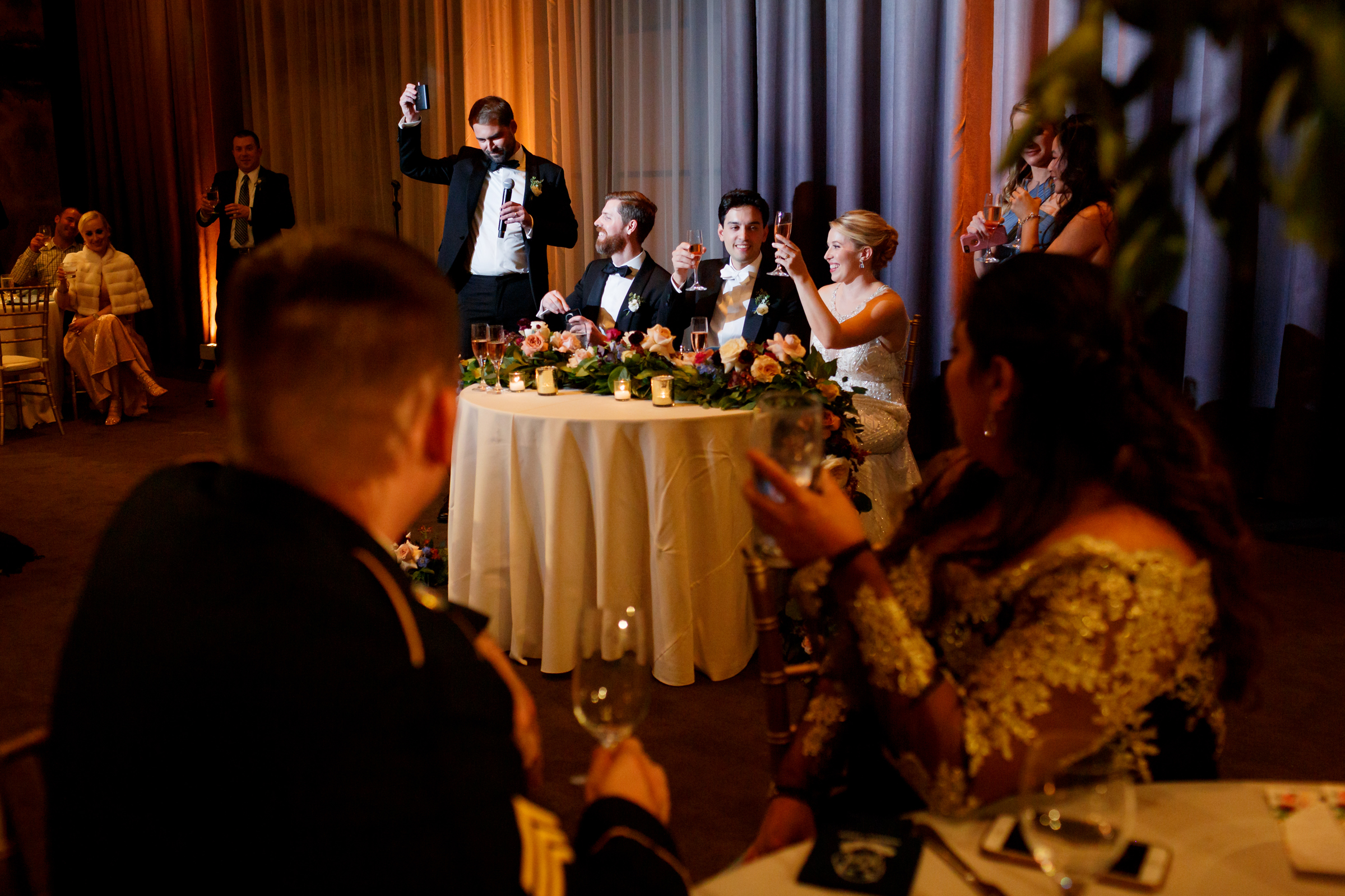 Raising their glasses for a toast - photo by Jenny DeMarco Photography