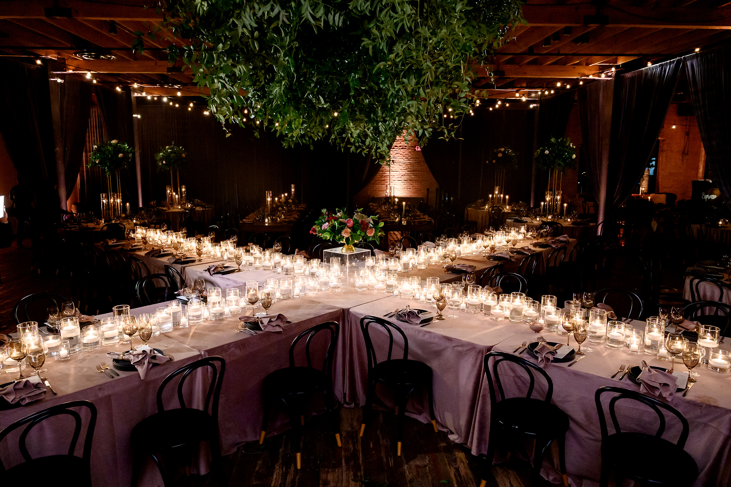 X-shaped reception table with candles - photo by Jenny DeMarco Photography