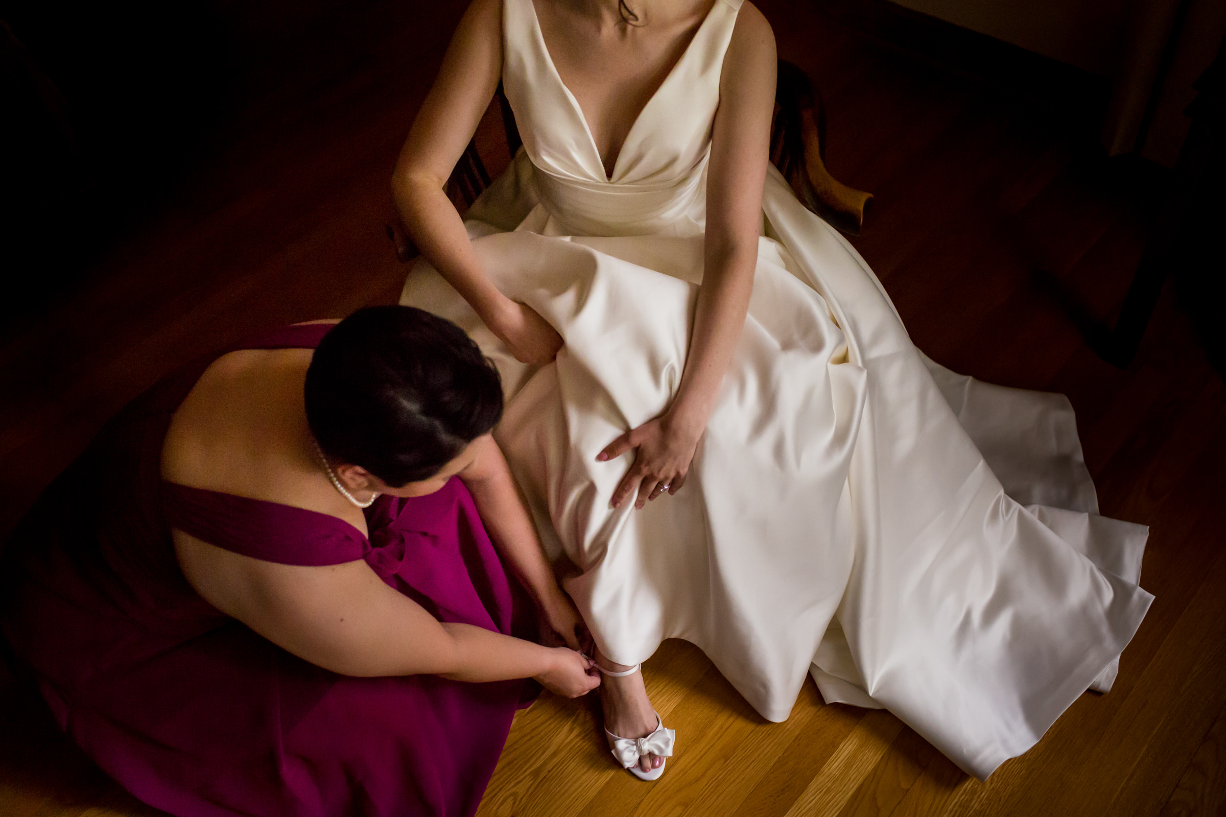 Assisting the bride with her shoes - photo by Procopio Photography