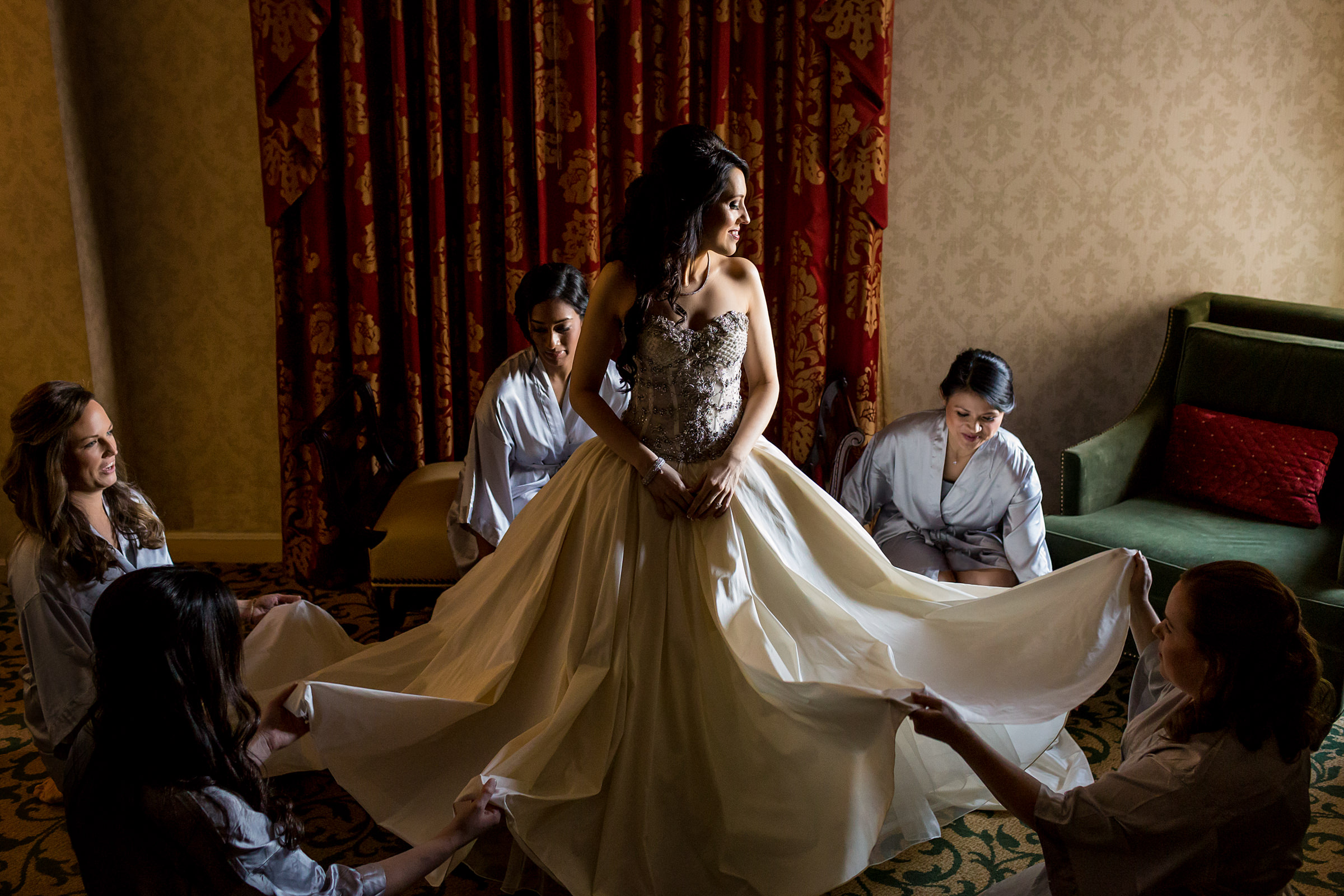 Bridal party arranging bride's gown - photo by Procopio Photography