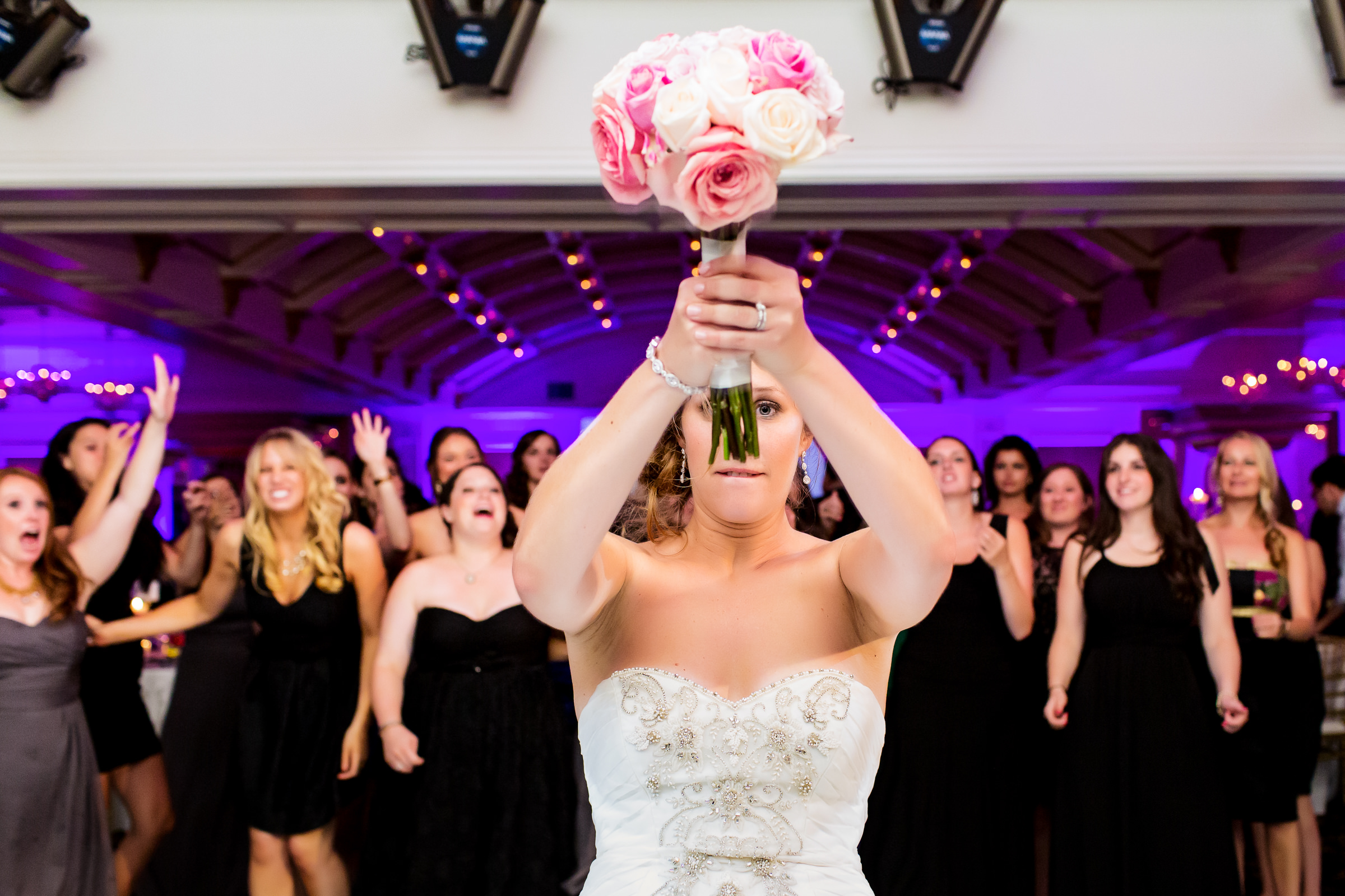 Bride about to toss the bouquet - photo by Procopio Photography