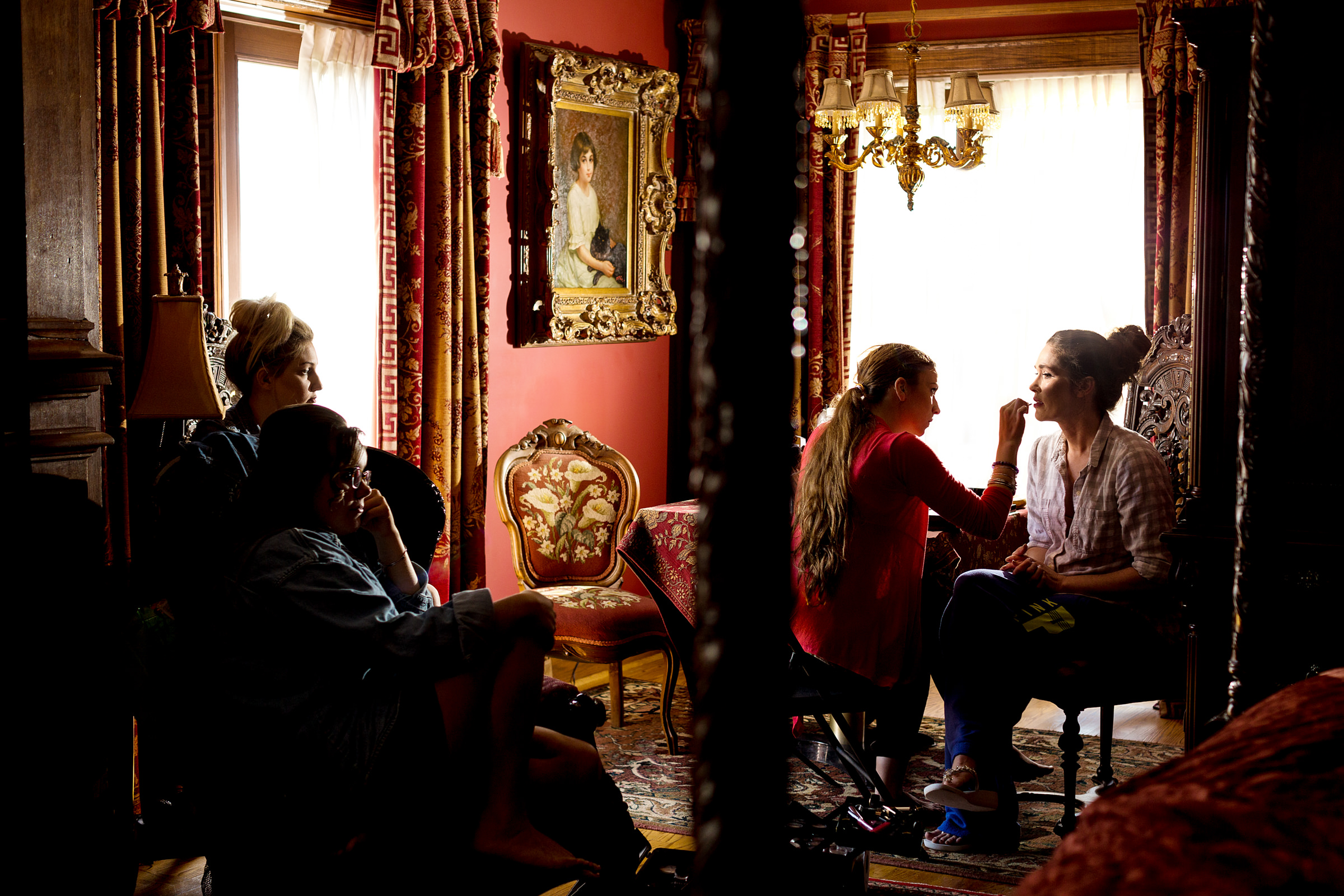 Bride being made up in luxurious sitting room of Gramercy Mansion - photo by Procopio Photography