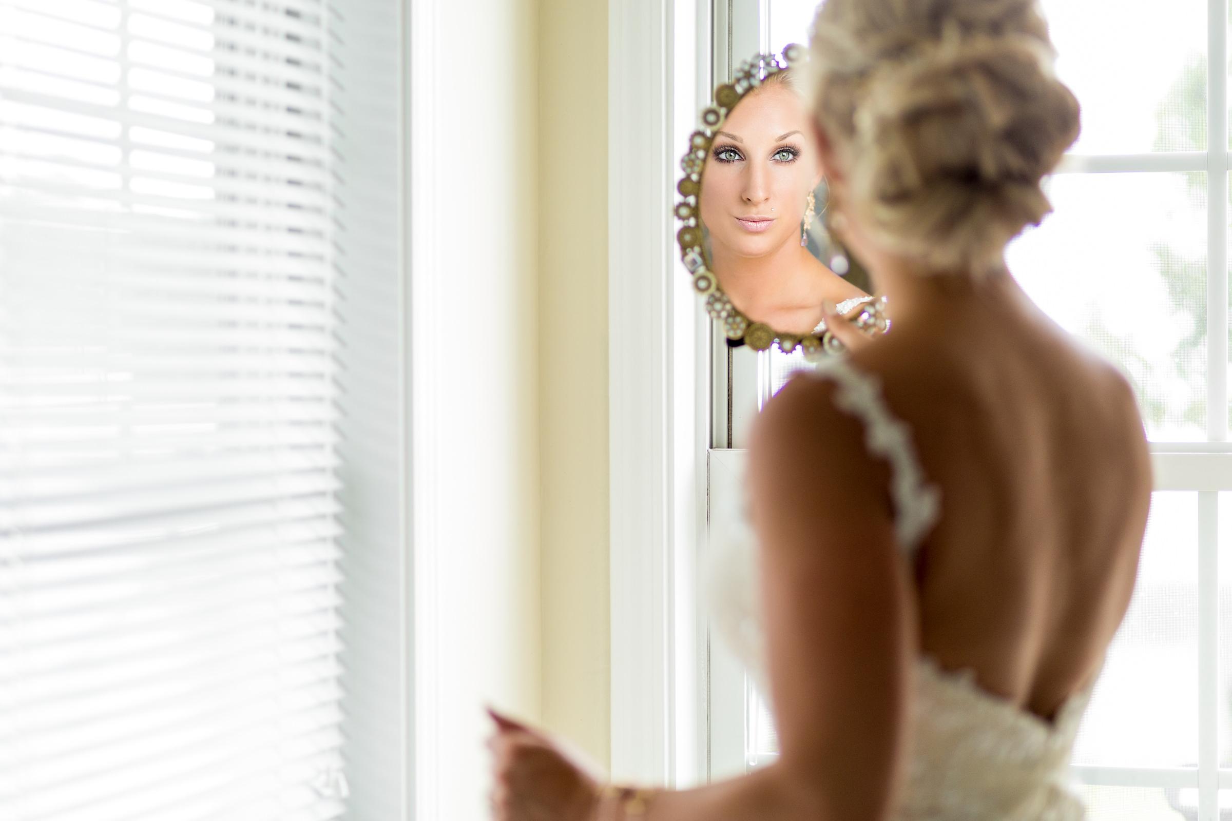 Bride face in mirror - photo by Procopio Photography