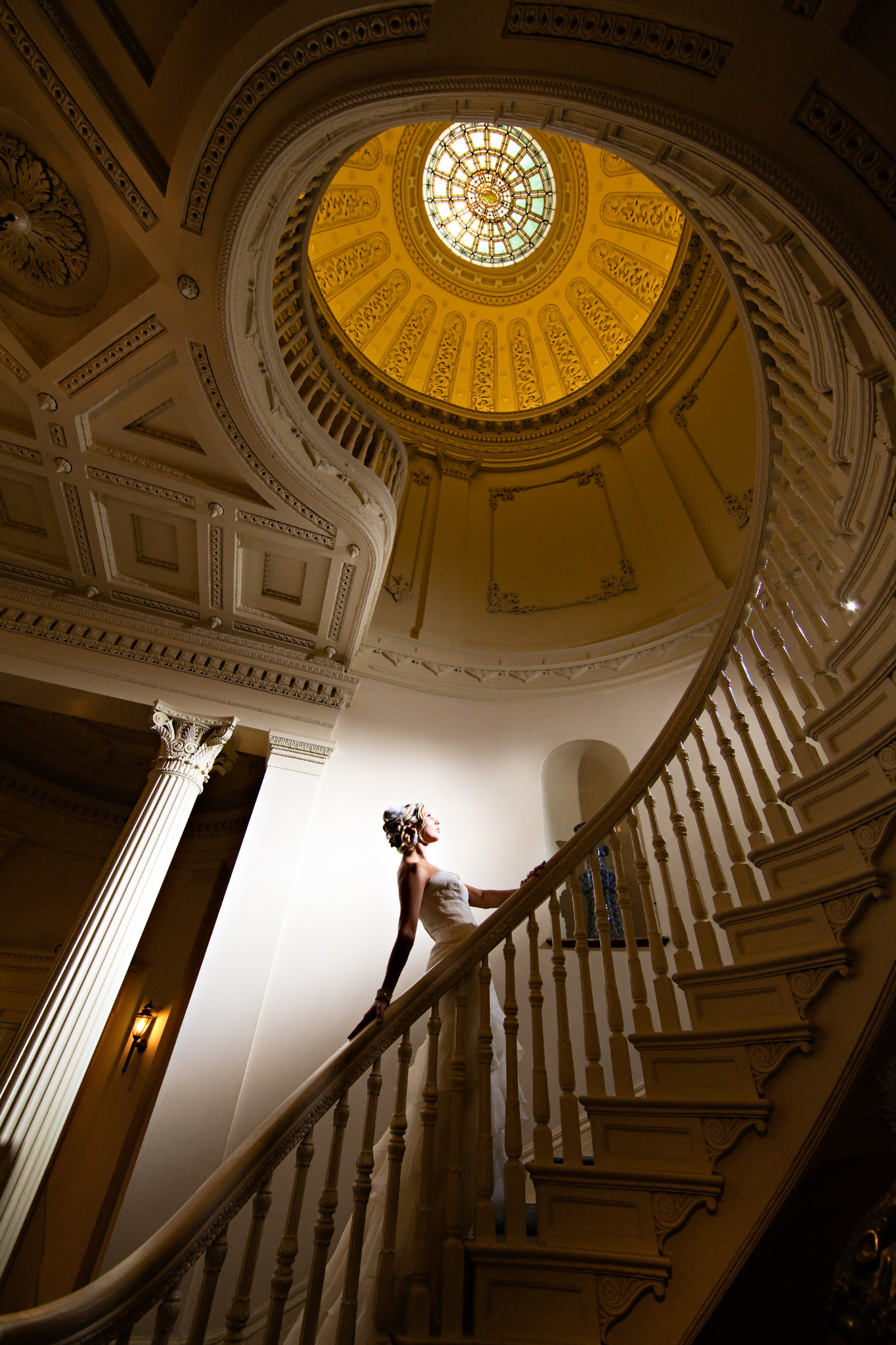 Bride pose on ascending spiral staircase - photo by Procopio Photography