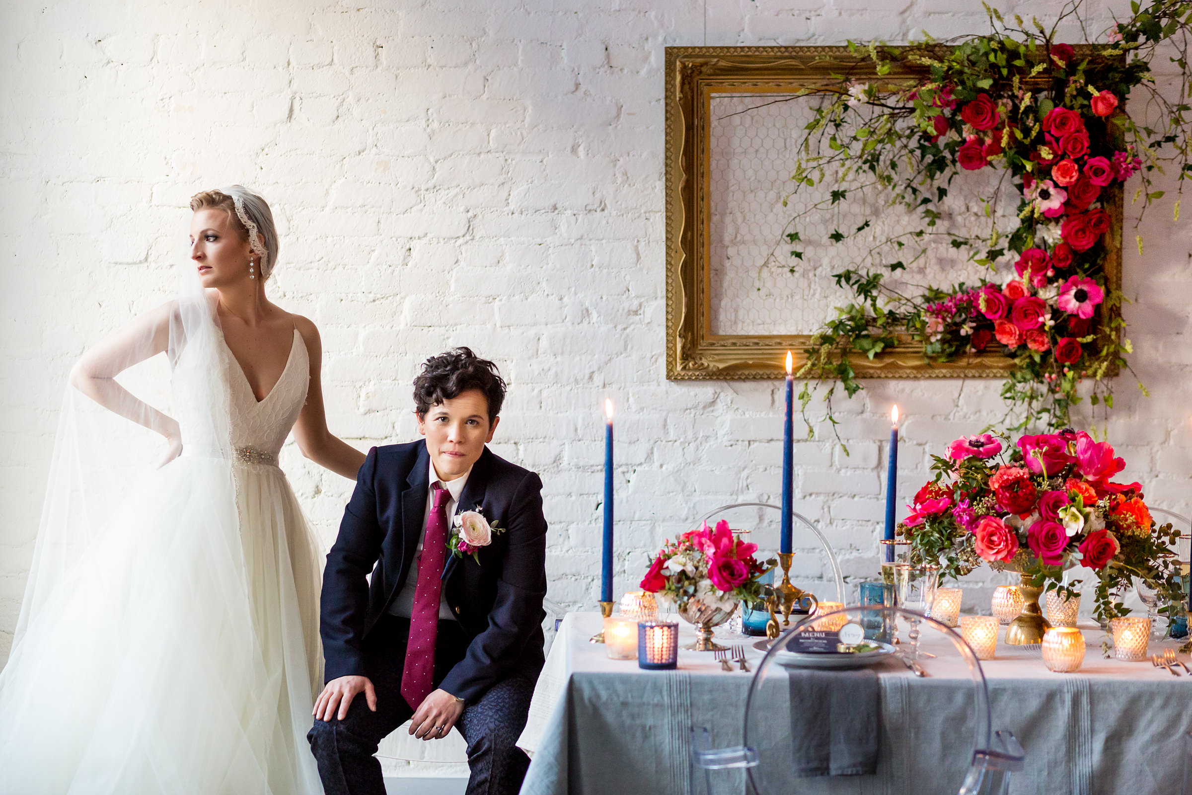 Brides at decorated table - photo by Procopio Photography