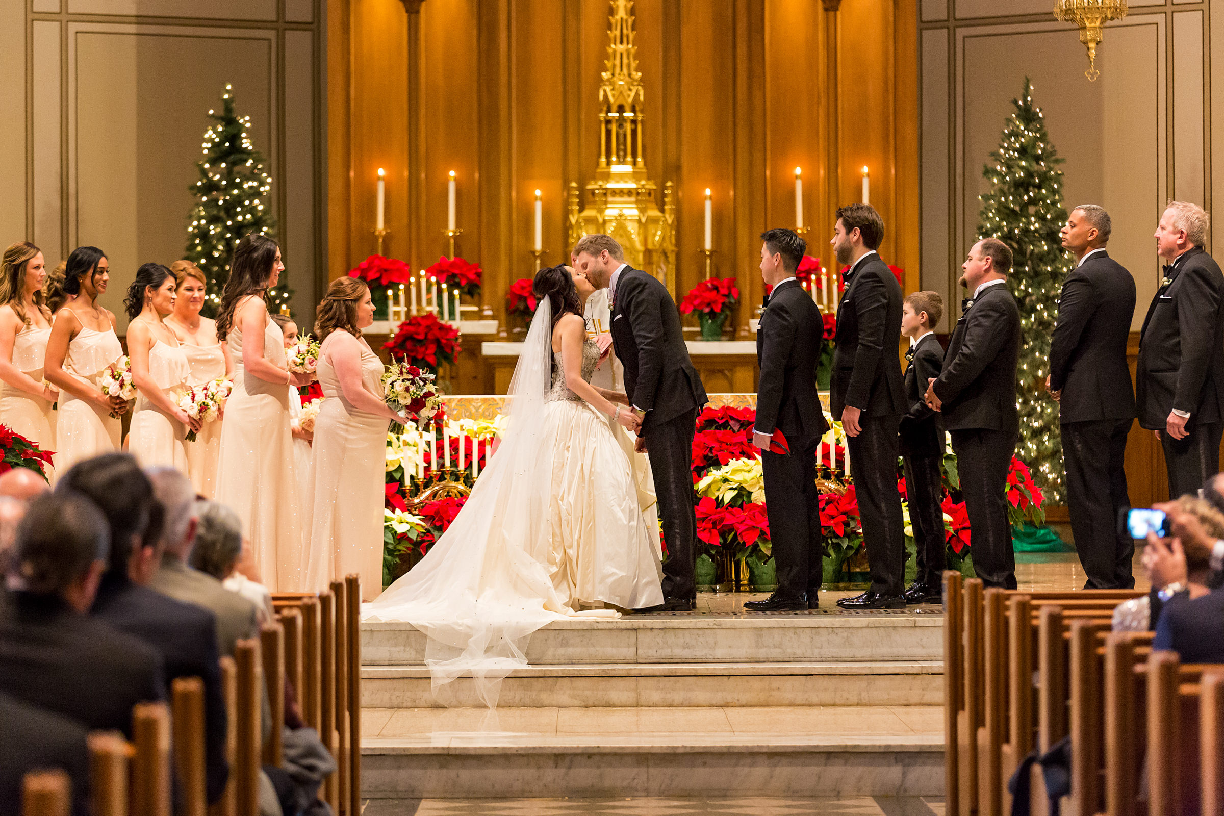 Ceremonial kiss at altar - photo by Procopio Photography