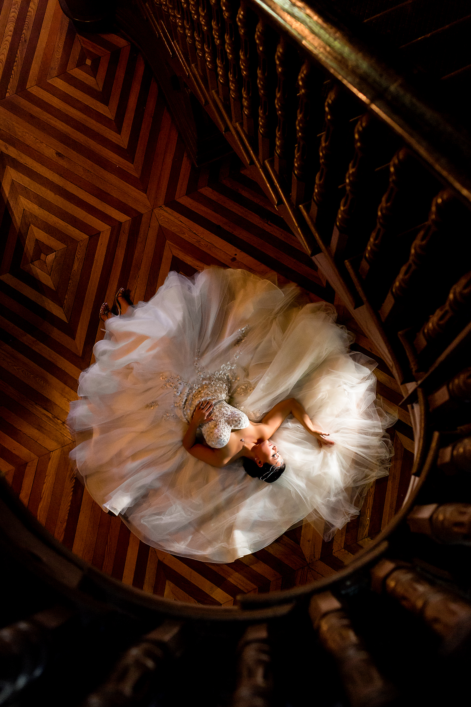 classic photo of bride laying on her dress at bottom of stairway - photo by Procopio Photography