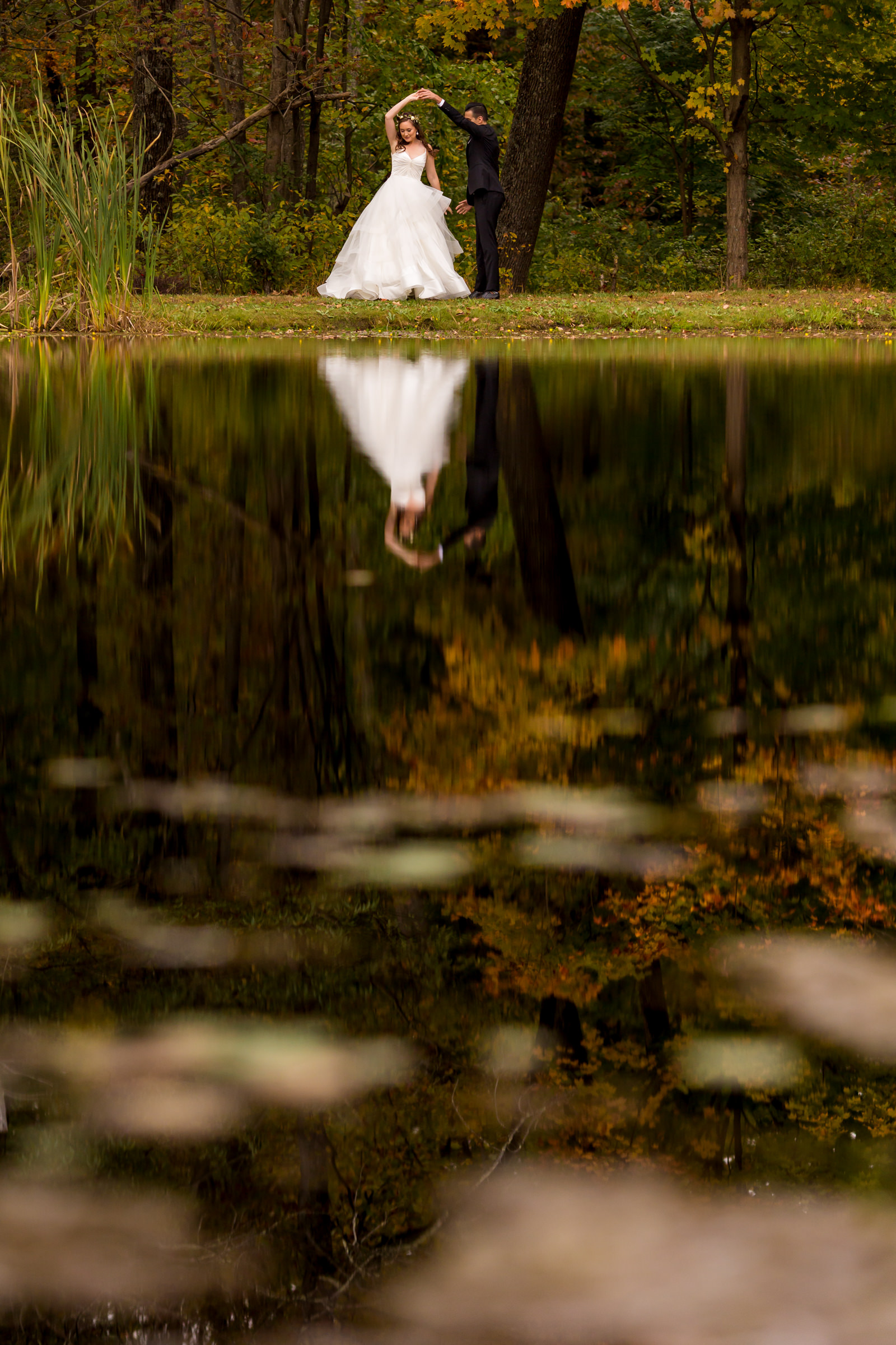 Couple dance pose reflected in lake - photo by Procopio Photography