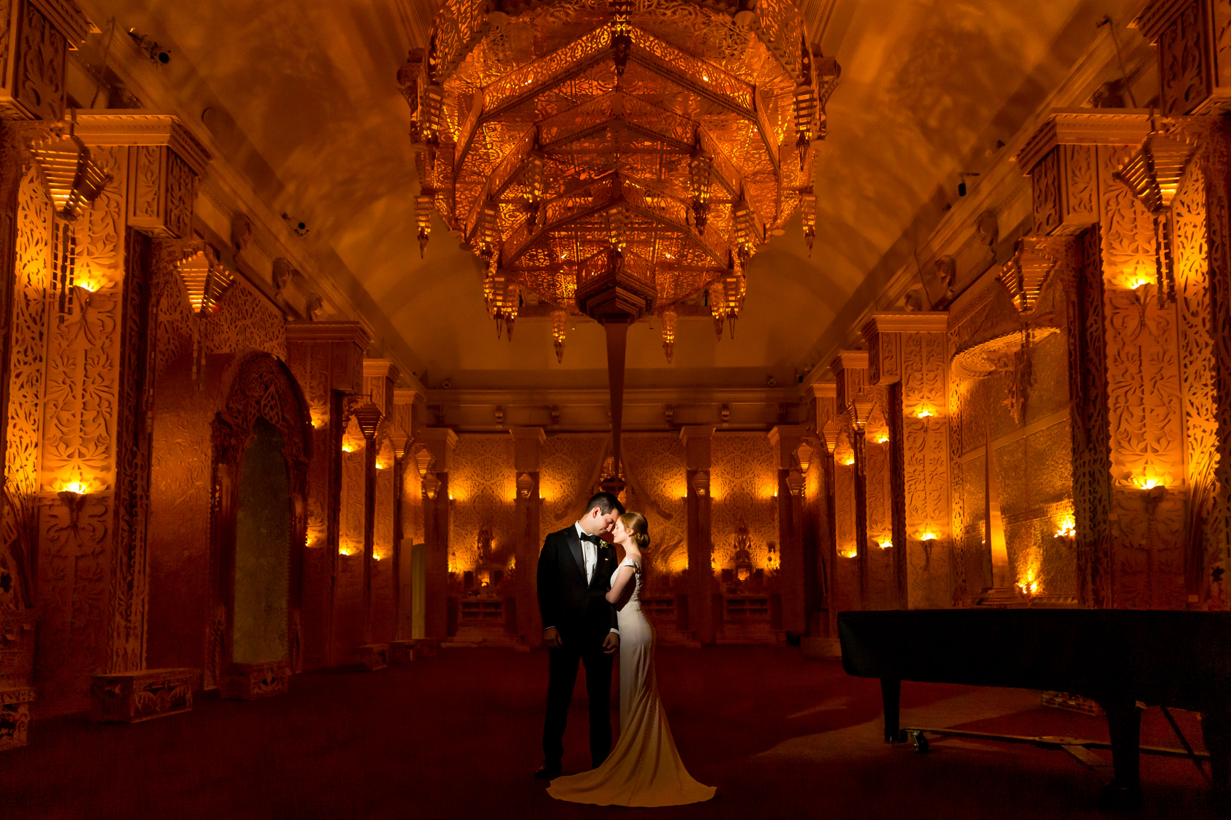 Couple in ornate lobby with chandeliers and sconces Hotel Renwick art gallery meridian house- photo by Procopio Photography
