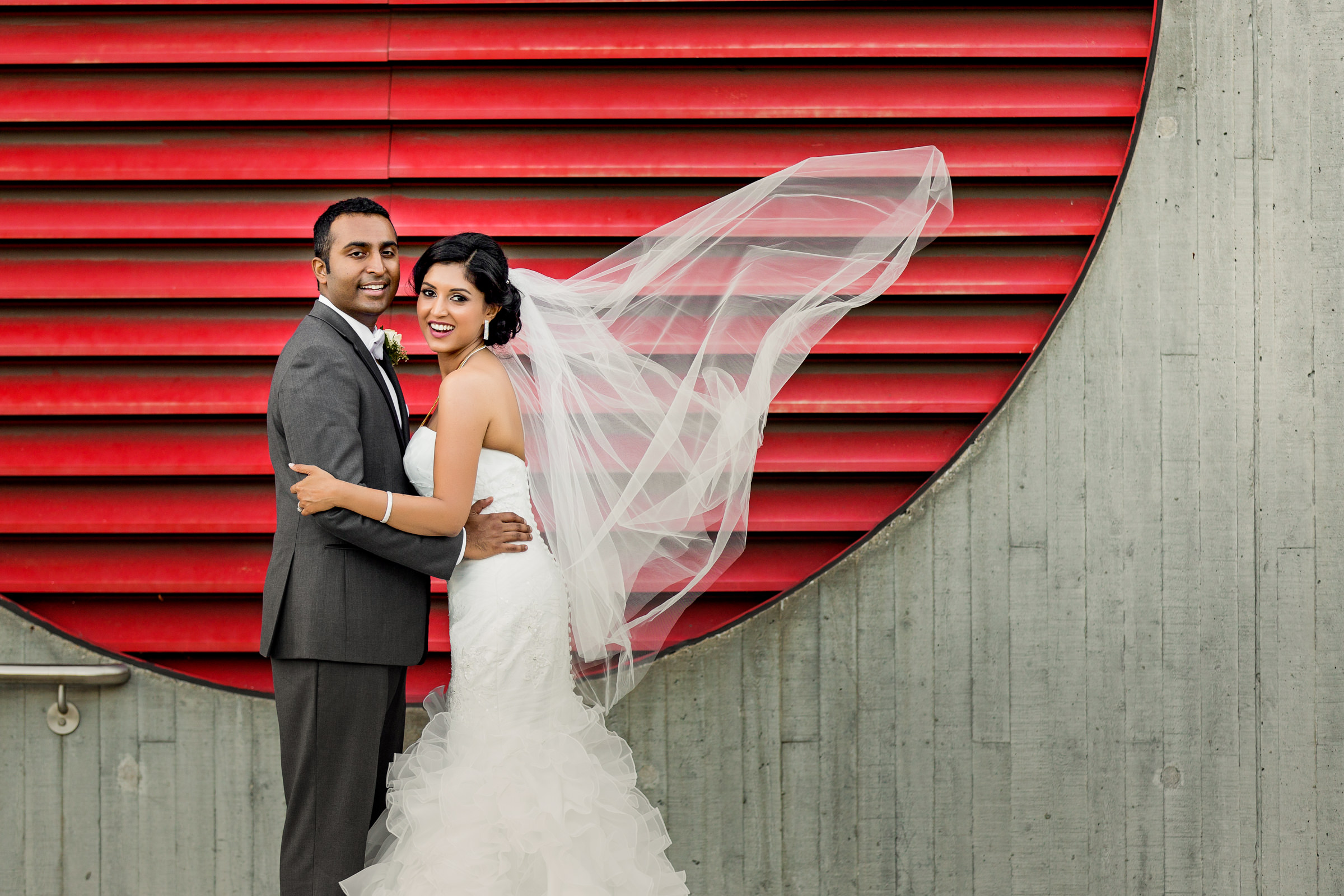 Couple portrait with bride's veil blowing - photo by Procopio Photography