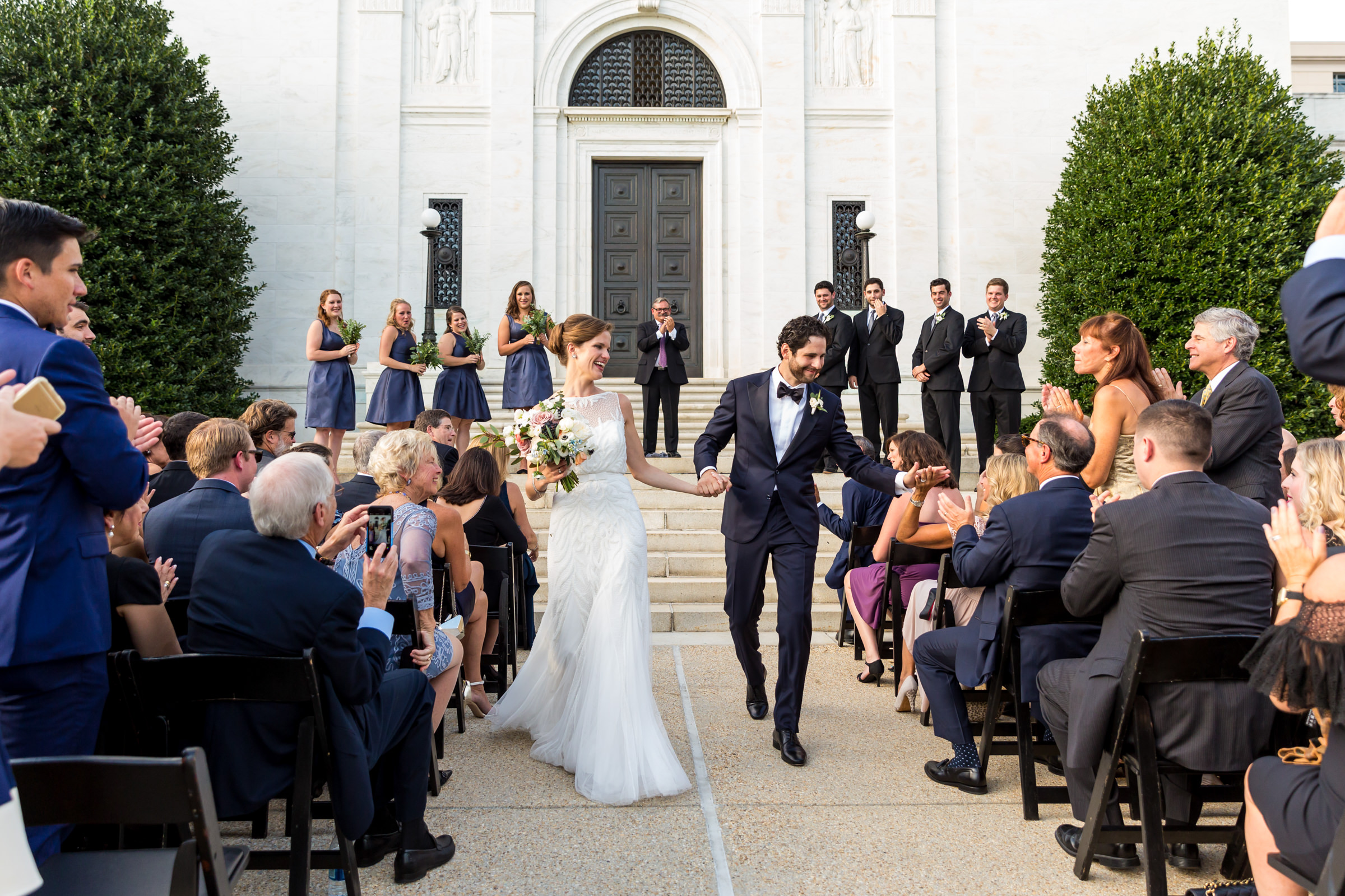 Couple walking up aisle through well wishers - photo by Procopio Photography